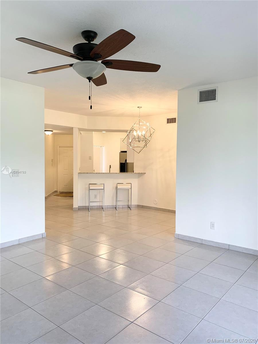In the  luxurious Grand Palms, Golf gated community, gorgeous first floor newly remodeled unit with 3 bedrooms, 2 baths with spectacular golf and grand lake views. This unit features two assigned parking spaces located in front of the unit, ceramic floors, stainless steel  appliances, eat-in remodeled kitchen with granite counters and Upgraded Bathrooms. HOA fee includes Water/Sewer/Trash, AT&T U-Verse, ADT Alarm Monitoring, Building & Roof Insurance, 24hr Security & All Amenities! The Grand Palms community features Jogging paths, child playgrounds, swimming pools, lush landscaping & gorgeous views with Mediterranean designed residences in a Resort Style Golf and Country Club community offering 27 holes of golf with differing levels of challenging play.