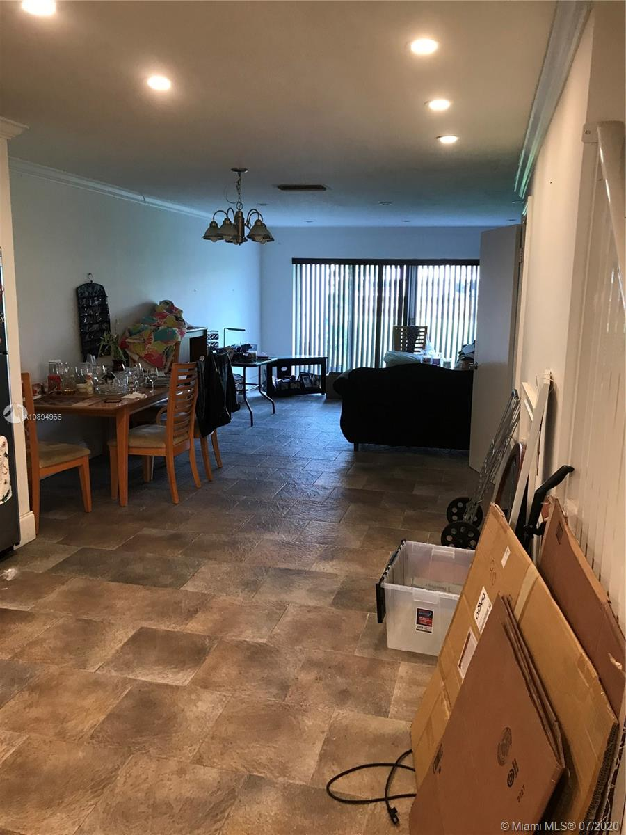 Beautifully Remodeled Townhouse in back of dadeland mall. The unit has a new kitchen, new bathrooms, new AC among other improvements. The association has approved their 40 year inspection and the complex is currently under a complete remodel. Currently a monthly special assessment of $146.40i s being paid for the 40 year inspection work. The assessment will finish in 2021.