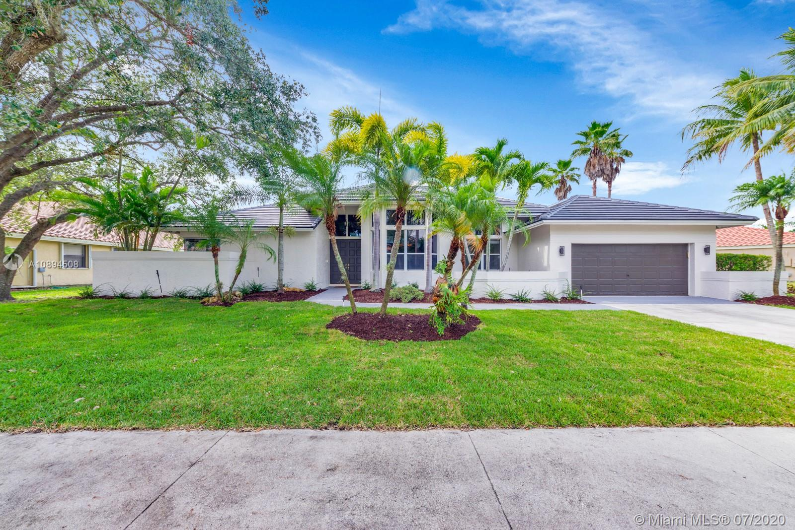 Enter the Gated boutique community of Palm Island. This custom one story is tucked on a private Royal Palm tree lined street, walking distance to community park, schools and Weston Town Center.  Enjoy four spacious bedrooms and 3 bathrooms. Soaring ceilings extensive crown molding, brand new 2020 roof. New A/C unit. Modern flooring throughout, new flooring in all bedrooms. Patio and backyard views from all main living areas  Oversized primary bedroom with his and her walk-in closets with built-ins, separate linen closet and a large bathroom suite with built-in marble tub and expansive shower. Many large windows bring in plenty of natural light. Updated kitchen with wood cabinets and stainless steel appliances, granite countertops Large lot with a large, grassy backyard.