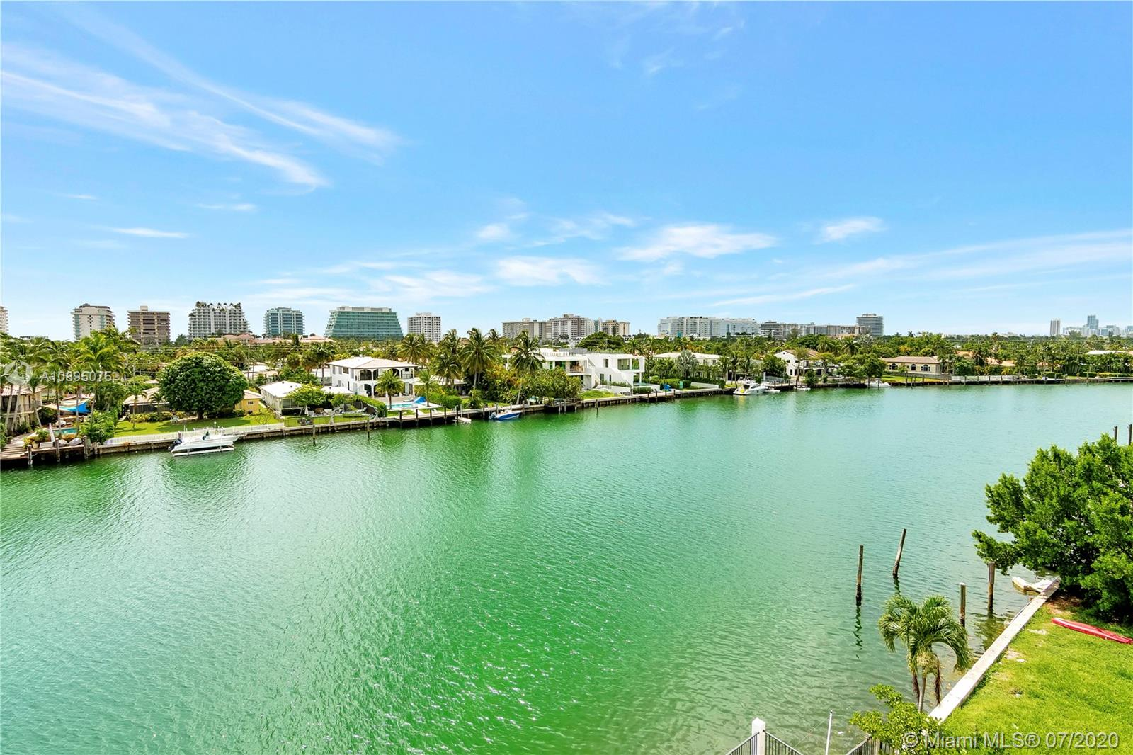 """Welcome to your new and fabulous home with breathtaking Bay, Canal, Ocean and City views! Location, location, location!!! This spectacular 2bed/2.5baths residence, just shy of 1700 sqft of living area is strategically located in desirable Bay Harbor Islands, one of the best School Districts in Dade County, Fl. with """"A"""" rated schools such as Ruth Kay Broad Bay Harbor K-8 Center and others, minutes from the beach, restaurants, houses of worship, prestigious-world known Bal Harbour Shops. It comes completely remodeled, move in ready; with travertine marble floors throughout, updated bathrooms and open kitchen, stainless steel appliances, granite countertops, customized lighting, closets, newer window treatments + additional storage space. Offered at $314 per sqft. Definitely a must see!!! One"""