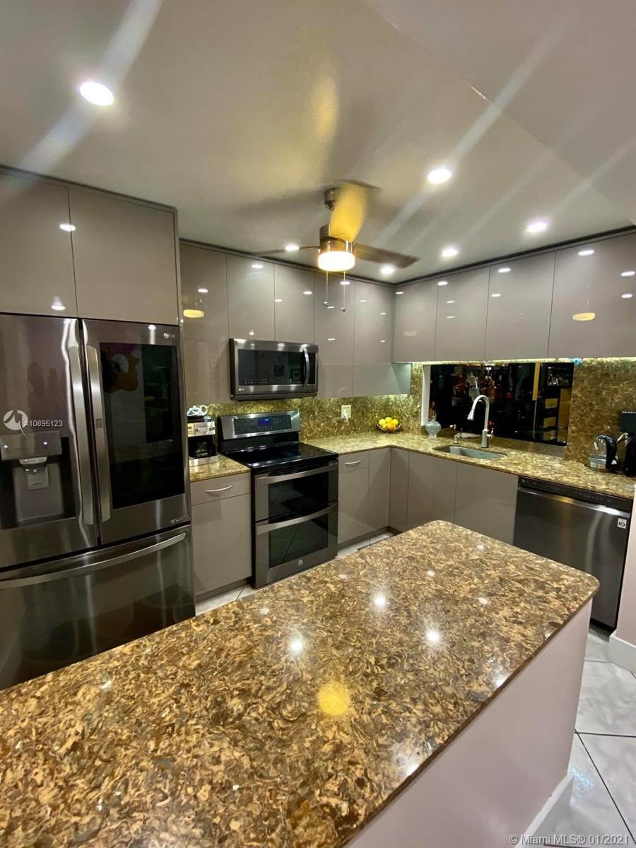 Welcome to a Pompano Beach hidden gem! What a great gated waterfront oasis to enjoy! PRIVATE DOCK AND FULLY RENOVATED. One fix bridge and 5 minutes to the ocean access by boat. Less than 5 minutes drive and 15 min walk to the beach.  This is by far one of the best units in the complex that's finally on the market for the first time in almost 20 years. Just renovated with spectacular european custom made in Spain kitchen with durable quarts counter tops and top of the line smart LG appliance package. Brand new bathrooms both with walk in showers, brand new A/C unit, brand new water heater, and a well maintained oversized private dock for an up to 28' boat. Lots of built ins throughout the unit.  Your dock has some of the best wide water sunset canal views in the complex.