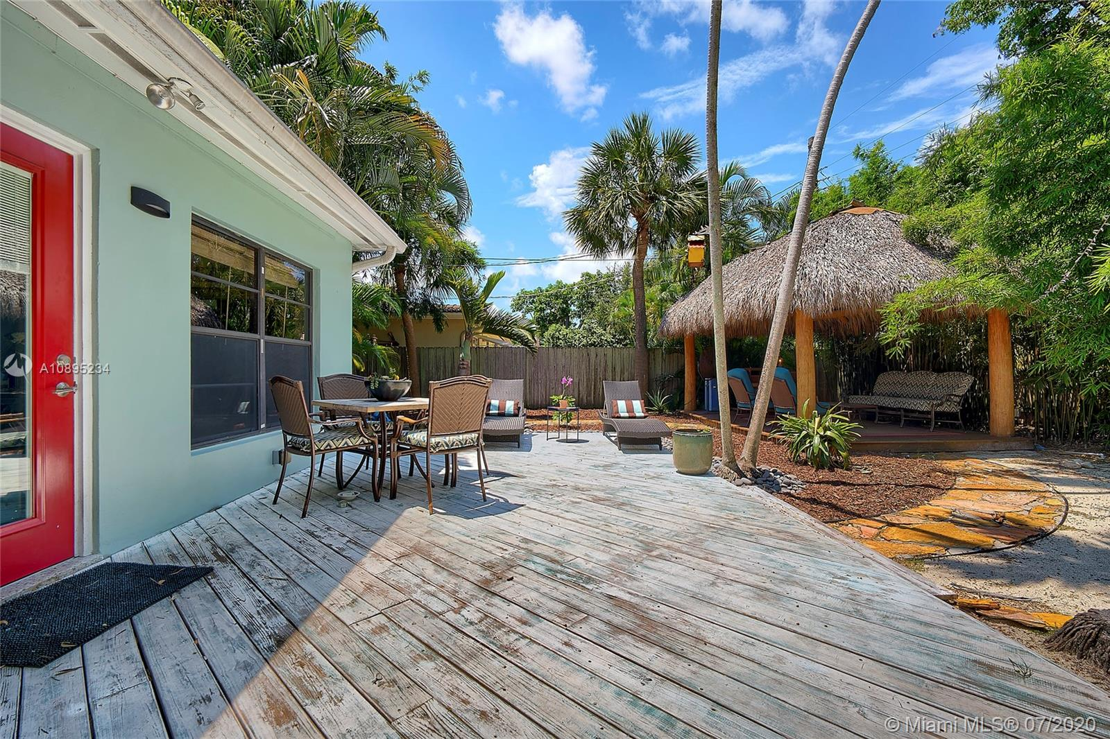 """During these times of """"staying in"""", imagine having a home that's YOUR OWN PRIVATE OASIS!  When everything is back to normal, you'll be hosting family gatherings, holidays or sporting events. OWNER PRIDE, this home has 3 bedrooms, 2 full bathrooms and a large gated carport. Enjoy your morning coffee in your tiki-hut listening to the birds while surrounded by tropical landscaping. Privacy fence surrounds the entire property. Hurry up because this one really WILL NOT LAST! Charming Victoria Park area. Located on a very quiet street, easy access to downtown Fort Lauderdale/Wilton Manors, 1 mile to the beach, shopping, movies, restaurants & entertainment. New roof 10/2018 (architectural shingle). AC replaced 2013. Bathrooms remodeled 2017. Wood burning fireplace."""
