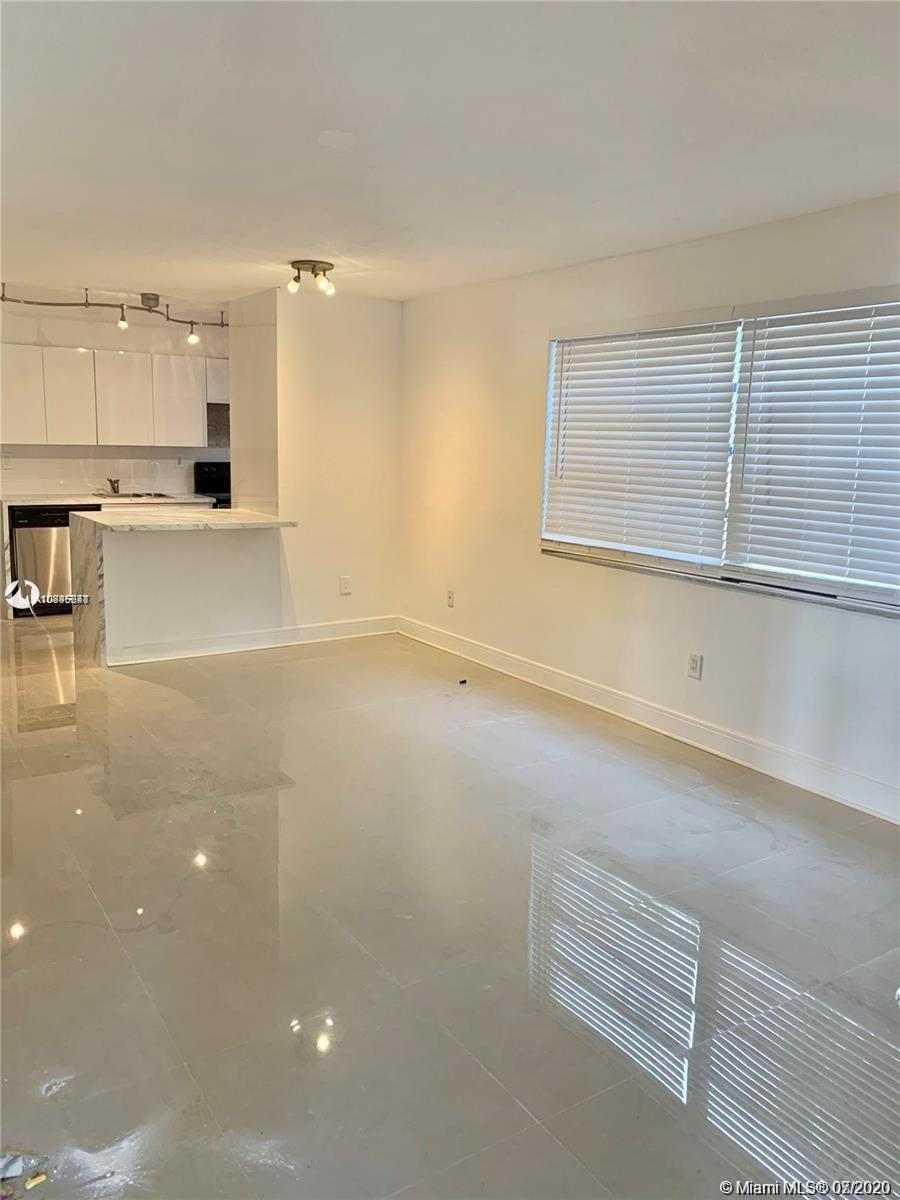 AMAZING LARGE ONE BEDROOM ONE BATH COMPLETELY REMODELED, KITCHEN WITH ALL WHITE LAMINATE NEW CABINETS, STAINLESS STEEL APPLIANCES, ALL WHITE FLOORS. UNIT IS ON THE FIRST FLOOR, VERY CONVENIENT, NEAR RUTH K SCHOOL, WALKING DISTANCE TO THE BEACH, BAL HARBOR MALL. UNIT IS RENTED FOR 1 Year.GREAT FOR INVESTORS.