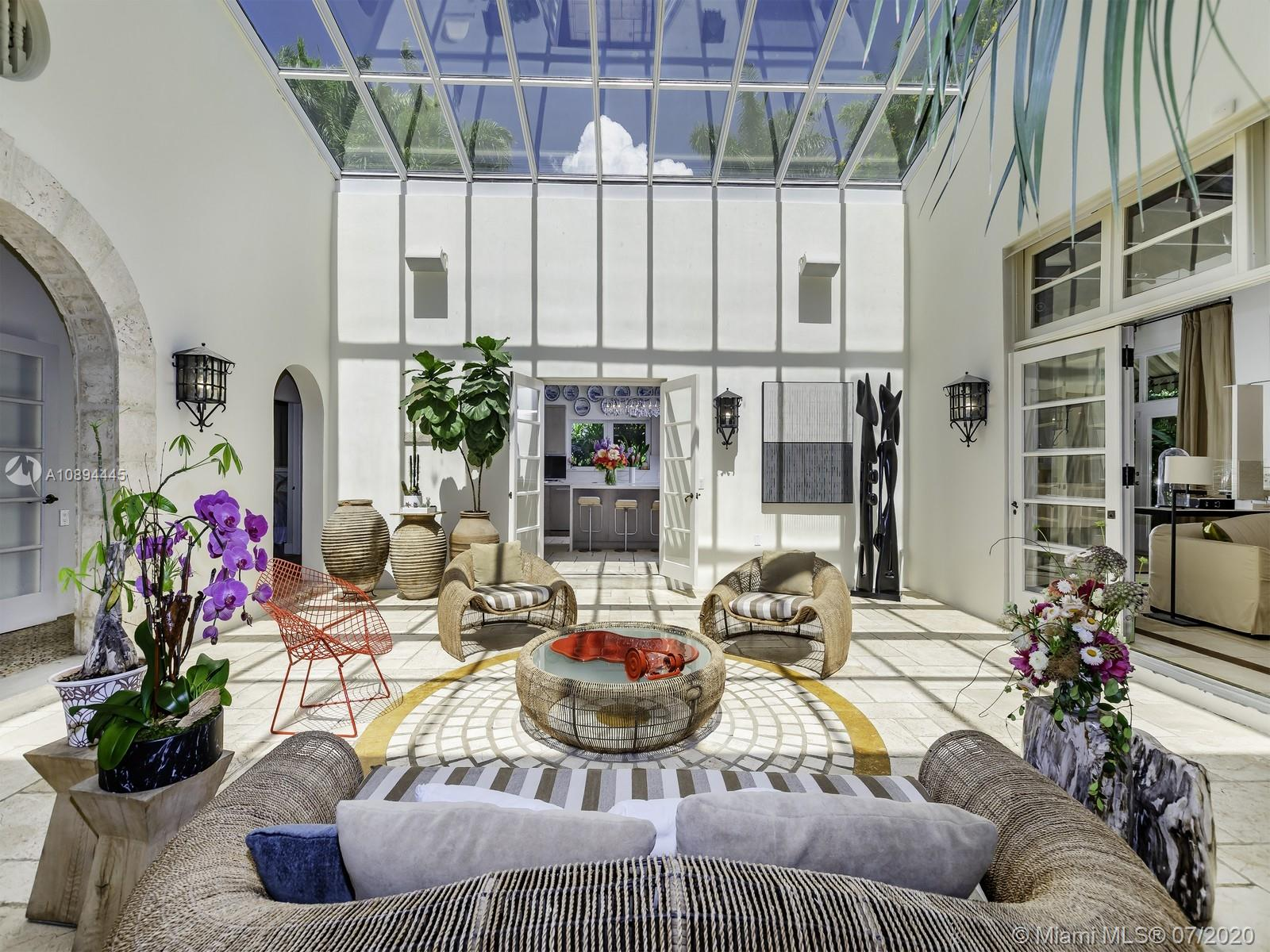 One of a kind tropical Coconut Grove oasis by renowned architect Walter C. DeGarmo. This 5,845 sqft adj Smart home sits on a beautiful 24,000 Sq.Ft lot, this home features wood & tile floorings as well as  5 bdrms + 5.1 bthrms, 2 car garage. 1st floor features courtyard style layout w/sunroof, formal living room & dinning room + foyer, 2 guest bdrms, half bath, family room, library area & completely updated kitchen w/Wolf gas stove & luxury appliances Subzero & Miele and quartz countertops & island. 2nd floor offers Master suite, updated master bath with steam room and stunning his and hers walk in closets + terrace + office with full bathroom. Guest home offers additional bdrm, bthrm, wine cellar + laundry. Stunning outdoor spaces with pool, lounge area + fountains