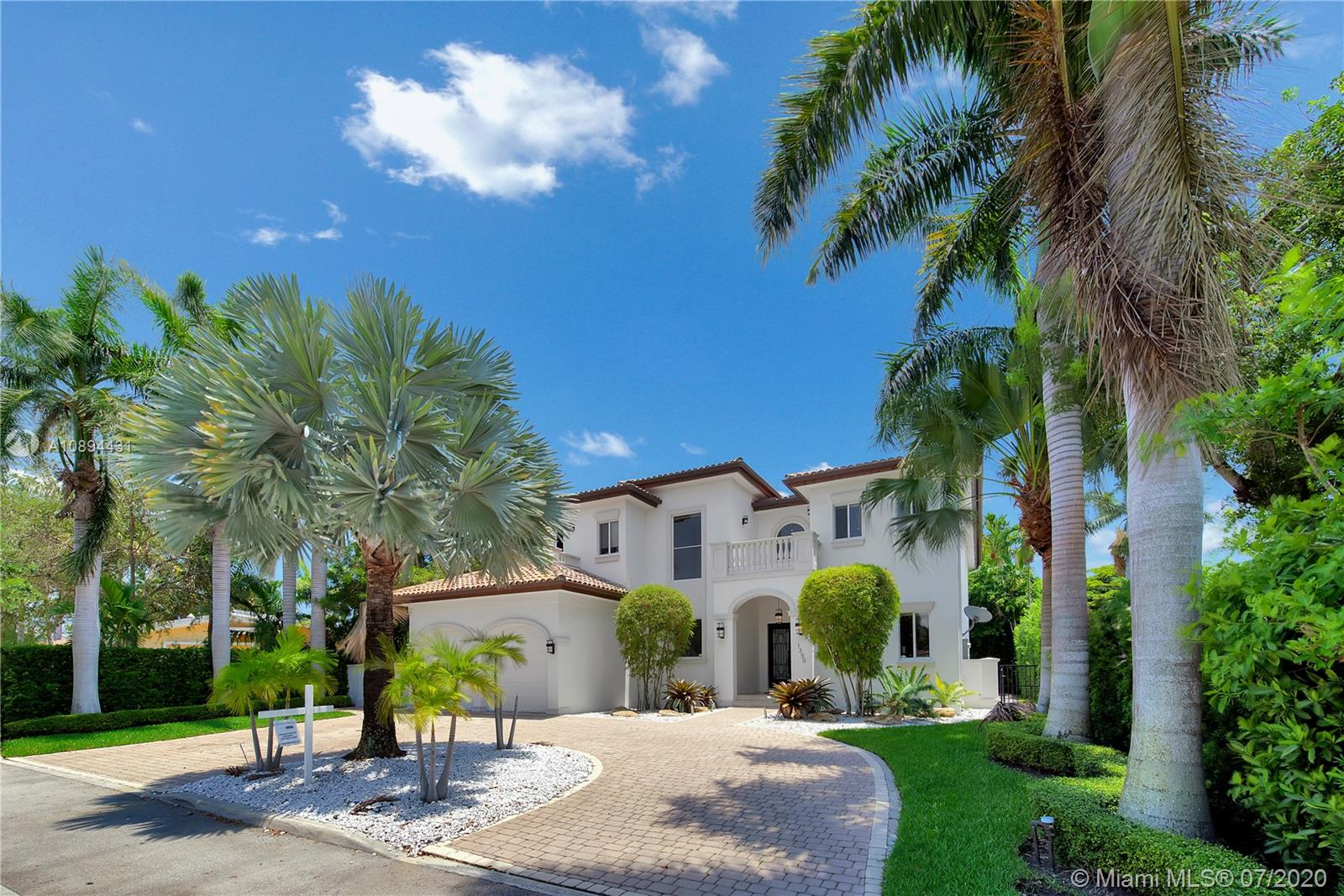 Stunning Modern Mediterranean residence perfectly located on prestigious Bay Harbor Islands. Please click on 3D tour to see for yourself. A Magnificent footprint w 4bd up/2 down,each w ensuite bath. Abundance of natural light thruout all living & entertaining spaces. New eat-in kitchen w adjacent family rm (Bosch range & ovens/Thermador refrigr/freezer) large pantry. Master suite w terrace, 2 enormous walk-in closets/luxurious bath.Expansive covered patio w summer kitchen & wood burning pizza oven made by world renowned Artist,heated pool w waterfall & private patio w mature trees.Elegant formal dining,dramatic living rm w double volume ceilings, 2car gar+storage, all impact window/doors, sep laundry rm. A+rated school, houses of worship, beaches, Bal Harbour Shops right down the street!