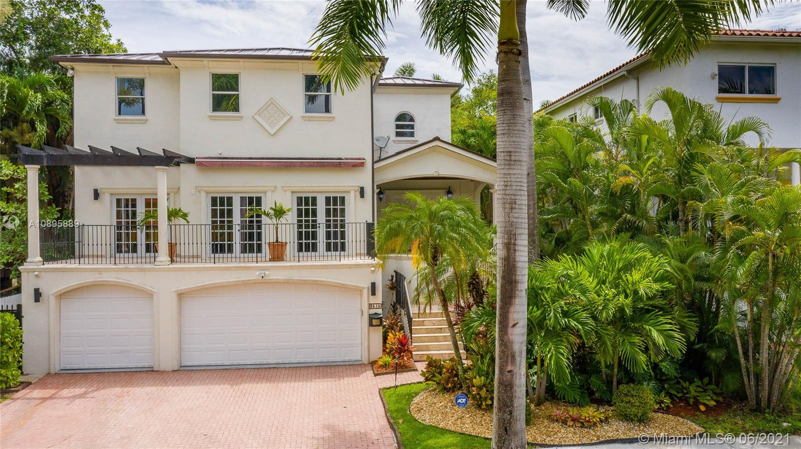 Luxurious tri-Level residence in North Coconut Grove near Vizcaya. In move-in condition. Complete smart home.Freshly painted. Brand new aluminum metal roof (2020).Marble floors throughout, all new remodeled kitchen with stainless steel appliances, gas gourmet cooktop, quartz counter top, impact windows & doors, whole house generator. 1st level 3-car garage, storage room can be wine cellar, 1/1 maids room off 1st level or cabana complete, huge covered terrace & pool, sprinkler system. 2nd level,20ft high ceilings,(2)foyers, living room,dining and family room open to kitchen, media room with full bath, wine coolers & (3) on-tap beer, pool table, theater room & more. 3rd level: Master suite with huge closets & balcony. Three additional bedrooms and (2) bathrooms.