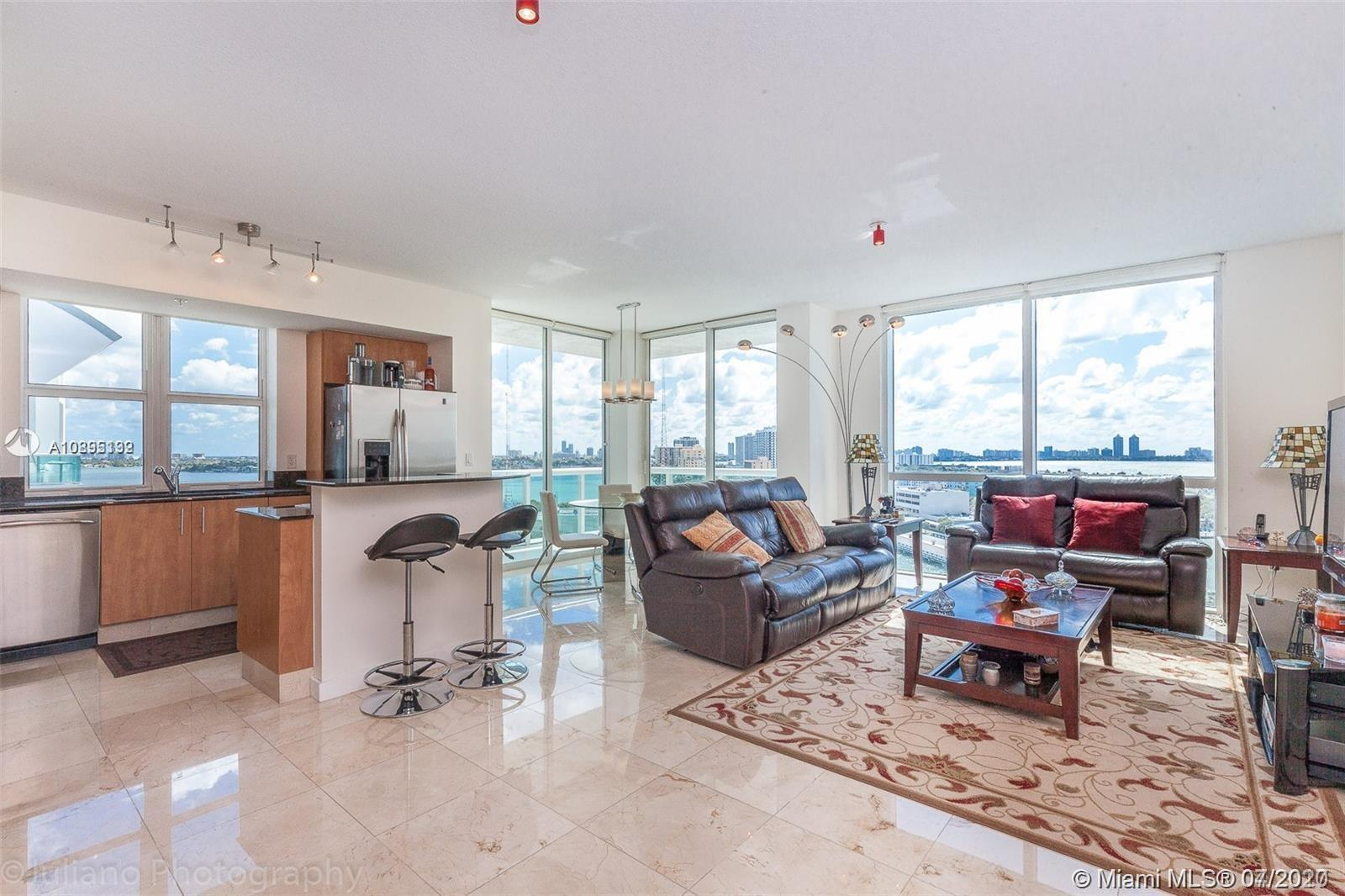 2-bedroom/2-bath + DEN at the lovely 360 in North Bay Village. Unit features marble floors in the living areas baths and kitchen. Unit is a corner unit with a wrap around balcony with spectacular views facing south east, overlooking Biscayne Bay and the Causeway. View of downtown skyline from the large balcony, which is completely private. Unit comes with 2 assigned parking spots and unlimited valet (free). 2 beautiful pools with cabanas/chaises, fantastic gym w/ sauna, 24-hour security. Association includes cable and internet