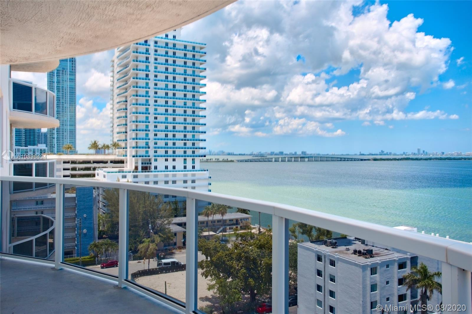 """Direct East facing Bay and Miami Beach Skyline views from this 3 bedrooms /2 Bath Condo in the """"Heart of Edgewater"""" Minutes from Downtown Miami and Midtown. The building offers a pool, gym and social room. Cherry laminate wood flooring in the living areas and Berber carpet throughout the bedrooms. The kitchen has stainless steel appliances and granite countertops."""
