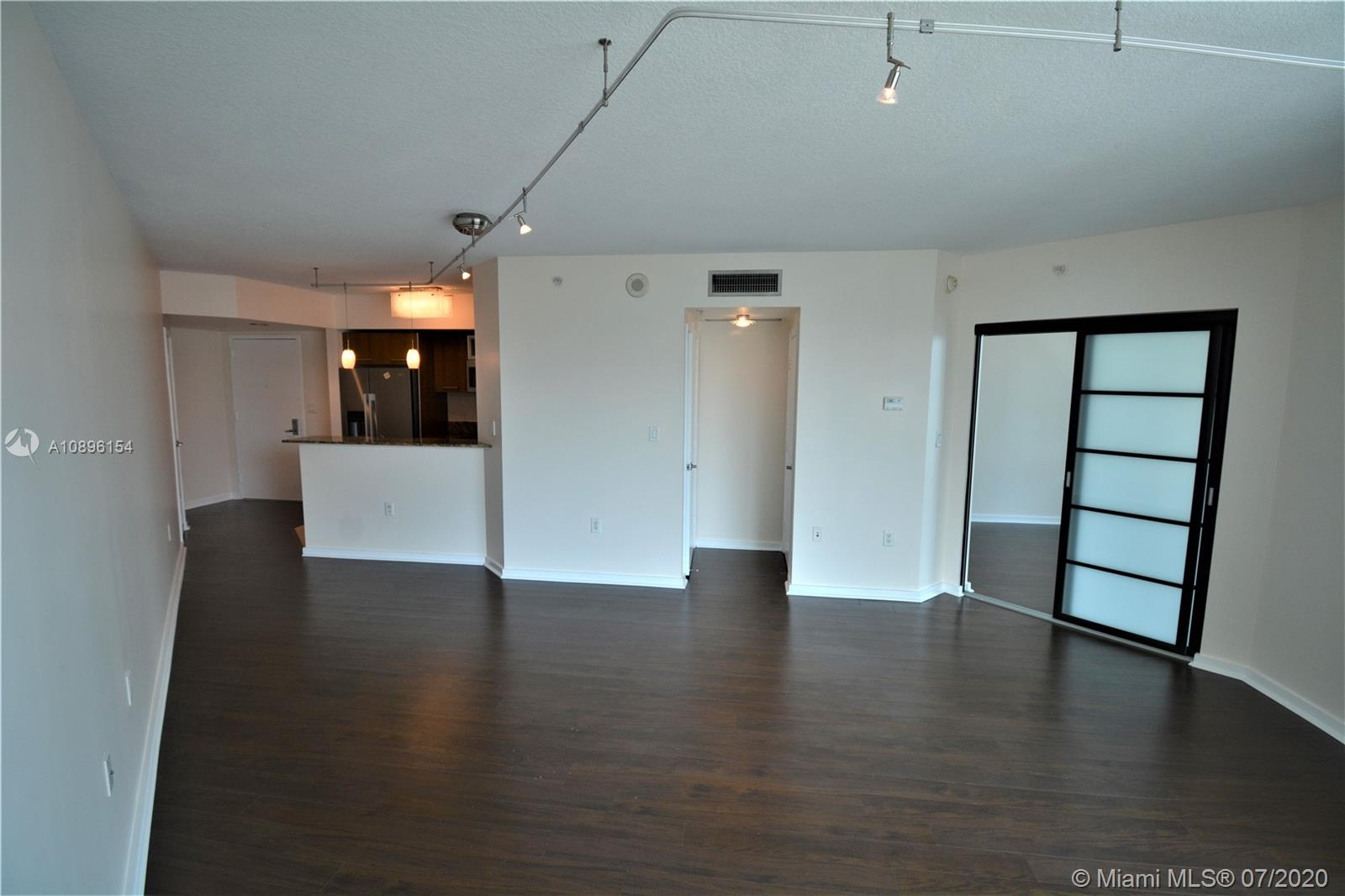 AMAZING 1/1 UNIT IN METROPOLIS, WOOD FLOORS, IN THE HEART OF DOWNTOWN DADELAND. OPEN KITCHEN WITH WOOD CABINETS, GRANITE COUNTER TOPS, S.S APPLIANCES, WASHER AND DRYER INSIDE UNIT, PANORAMIC VIEWS OF MIAMI'S GREEN TOPS AND EVEN BISCAYNE BAY, LARGE BALCONY. AMENITIES: 2 POOLS, JACUZZY, SAUNA, GYM, FULL SECURITY, POOL TABLE, VALET PARKING, CLOSE TO METRORAIL, WALK EVERYWHERE!. EASY TO SHOW. AGENTS MUST ACCOMPANY TENANTS TO SEE THE PROPERTY.