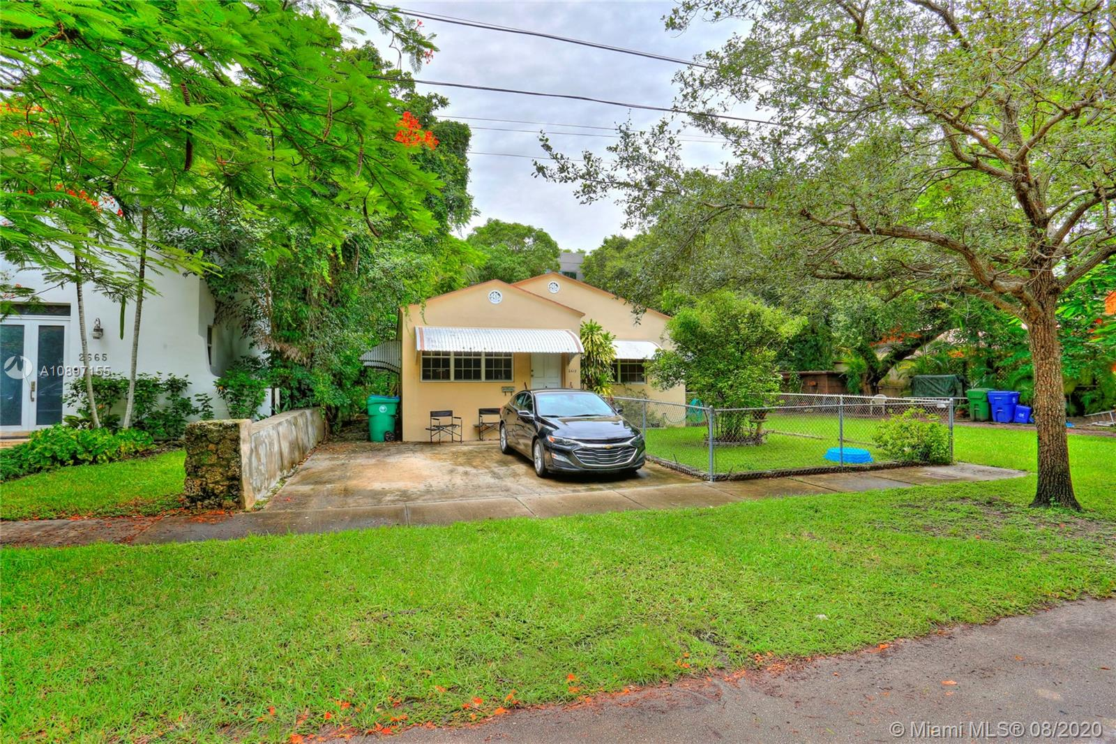 Opportunity to live on a quiet tree-lined street in prestigious North Coconut Grove, just a short walk to bayfront parks & marinas. Rebuild the existing structure or build a new construction home. The lot is located at one of the highest sea-level elevations in South Florida (not in a flood-zone). Close to the Grove village center's galleries, boutiques & cafes and minutes to downtown, MIA, Coral Gables, Key Biscayne & the Beaches.