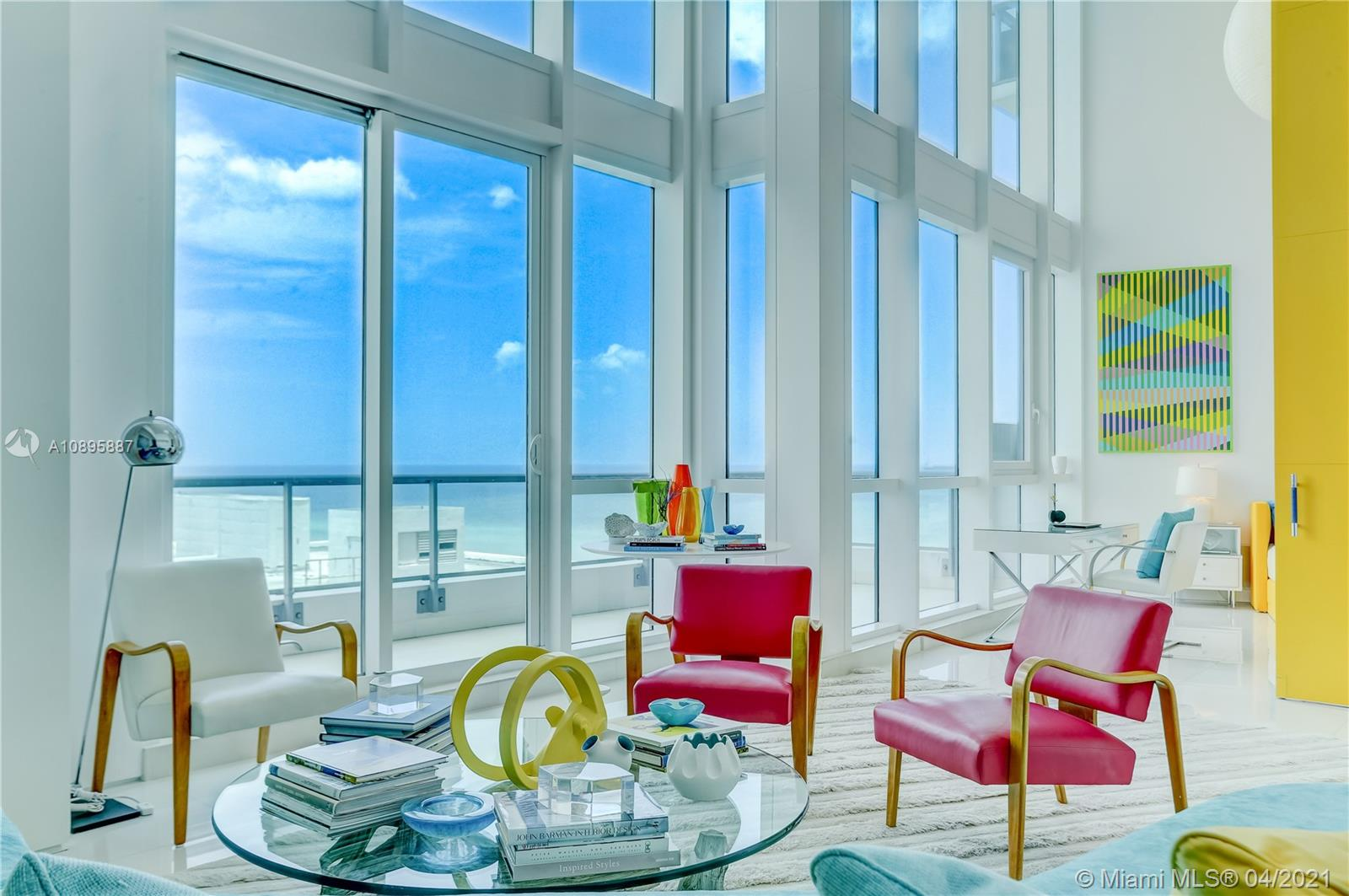 Stunning ocean views from soaring 20 ft ceilings in this famous designer finished condo. Spacious 1565 sq ft interior was featured in Architectural Digest. White floors & kitchen highlight the blue ocean all around. Northeast view of the ocean, the city, and the nearby W hotel.  Setai is one of the LEADING HOTELS OF THE WORLD Situated directly one the ocean offering 3 pools, private beach service, 2 restaurants, full gym and spa, full bar, concierge, valet. unparalleled service. Stroll the Boardwalk to all attractions of South beach: RENT DAILY, WEEKLY,  MONTHLY:  NO RENT RESTRICTIONS.