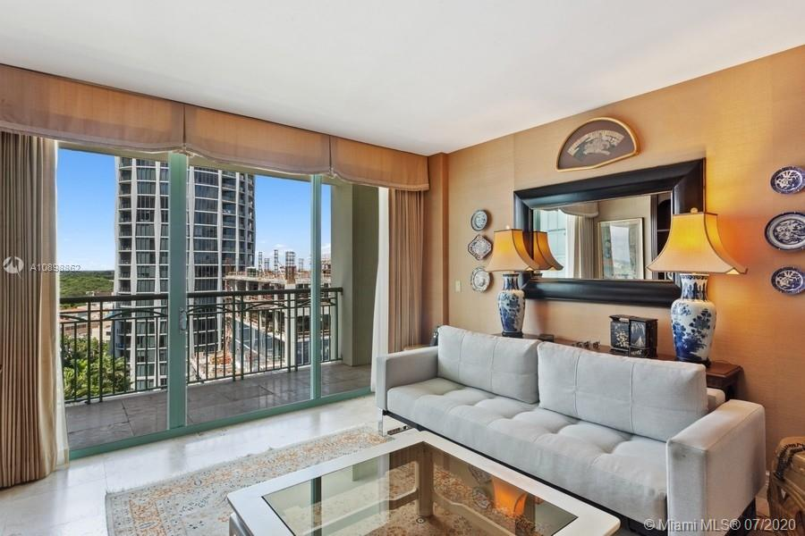 Best priced 1BR/1.5BA in the building!  This residence offers Coconut Grove, lush tropical landscaping and partial bay views. Other features include marble floors throughout, spacious bedroom with large walk-in closet and spacious bathroom with double sinks, separate tub/shower and marble floors and countertops. The kitchen is open to the living room with granite countertops and stainless steel appliances. The expansive terrace stretches the length of the apartment with access from the living room and bedroom. Live the Ritz-Carlton lifestyle and benefit from all of the exclusive amenities and services offered. Enjoy Isabelle's Restaurant, The Commodore bar & lounge, pool, cabana's, poolside cafe, concierge, fitness center and spa. Private and secure resident entry. Walk to everything!