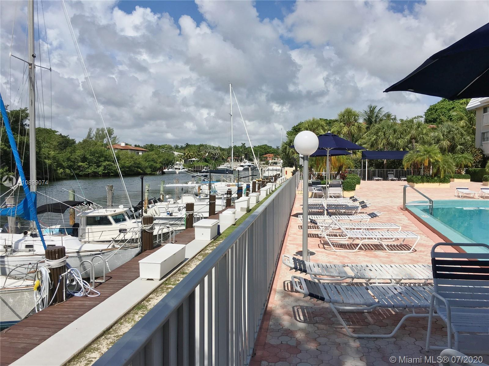 Beautifully remodeled top floor 2 bedroom 2 bath corner unit in waterfront boutique building with no bridges to bay. New stainless steel appliances, PGT hurricane impact windows, quartz counter tops, custom wood cabinets, recessed lighting, new Aquasana water filtration system, Grohe shower fixtures, tankless water heater, walk-in closets. Incredibly charming daybed reading nook. New doors installed throughout. Lounge by the pool and enjoy this boater's paradise, with 5 minutes to bay. Large bonus storage room + storage cubby. Prime parking space.