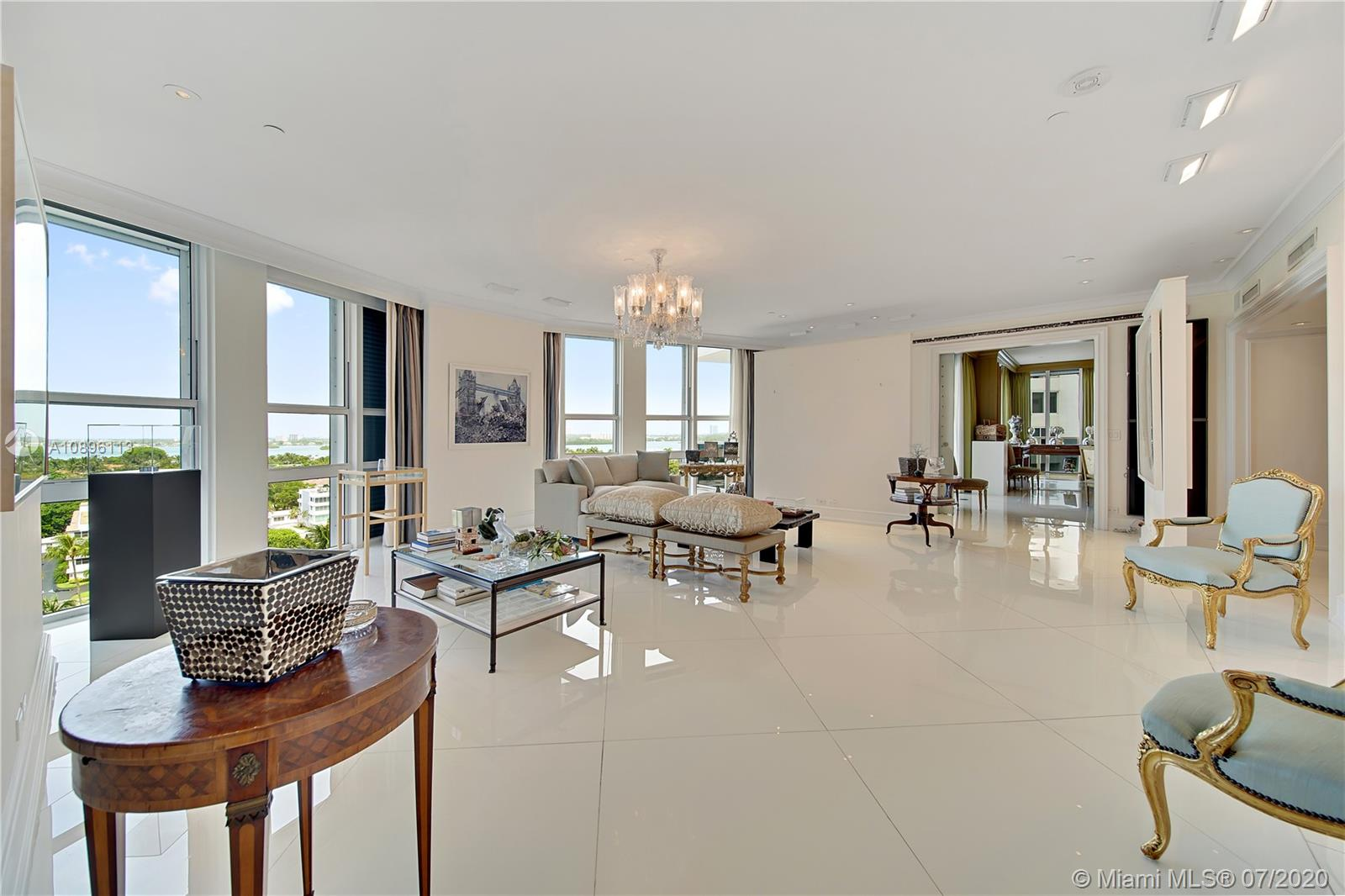 Sophistication and luxury meet in this 6 BD, 6/1 BA custom combination unit in exclusive ocean front Bellini in Bal Harbour. Perfect for a large family. Private elevator and foyer entry. Light filled living areas with floor-to-ceiling windows include den, living room, large formal dining, and breakfast nook. Multiple oversized balconies with ocean, bay and city views. Ample sized rooms with marble baths and custom built-in closets. Spacious kitchen with generous counter top area, snack bar, cooking island and butler's pantry. Marble and wood floors. Maids quarters. Residents enjoy a full-service building with heated swimming pool and spa. 2 assigned parking spaces and valet. Minutes from houses of worship fine dining and shops.