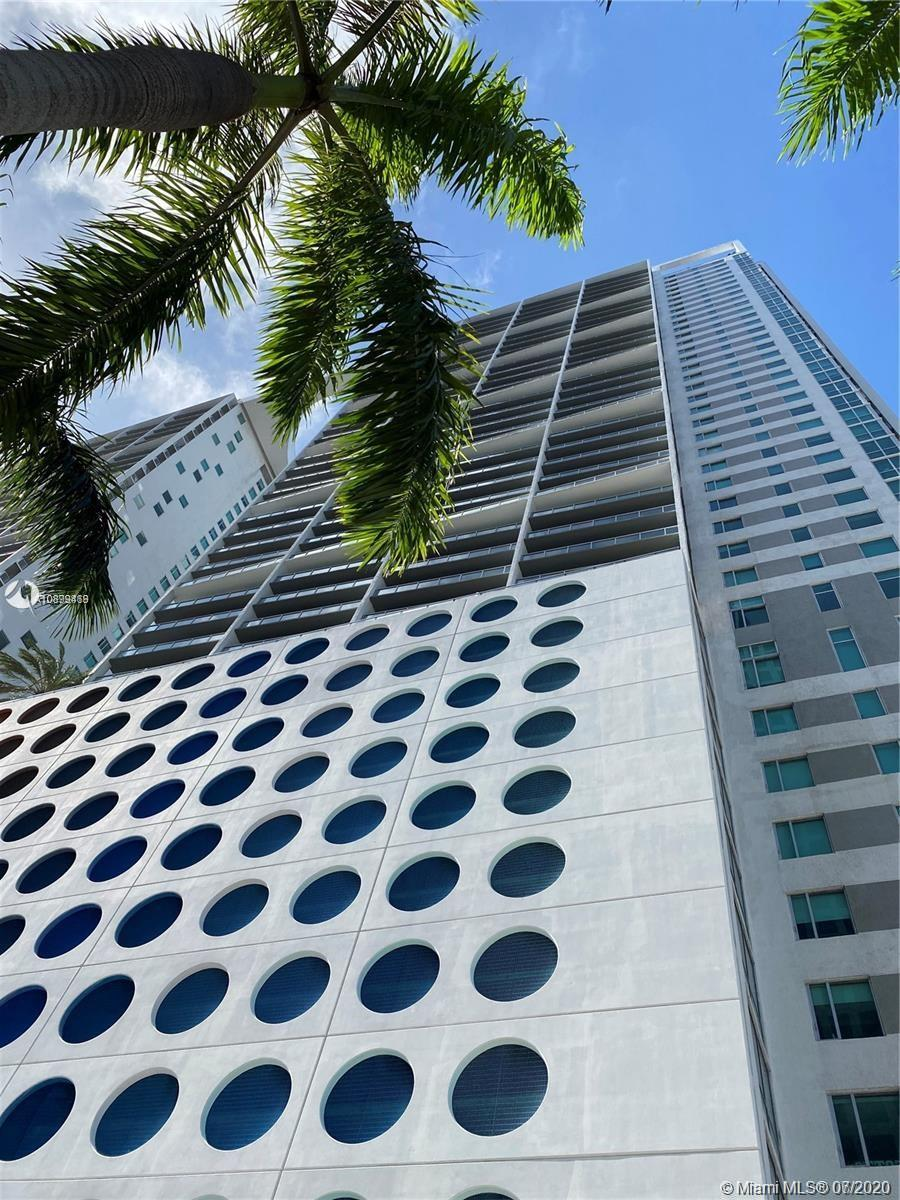 Stunning view from balcony of  the 28th floor of this 1 bedroom condo unit in beautiful 500 Brickell East.  spacious unit with excellent amenities.