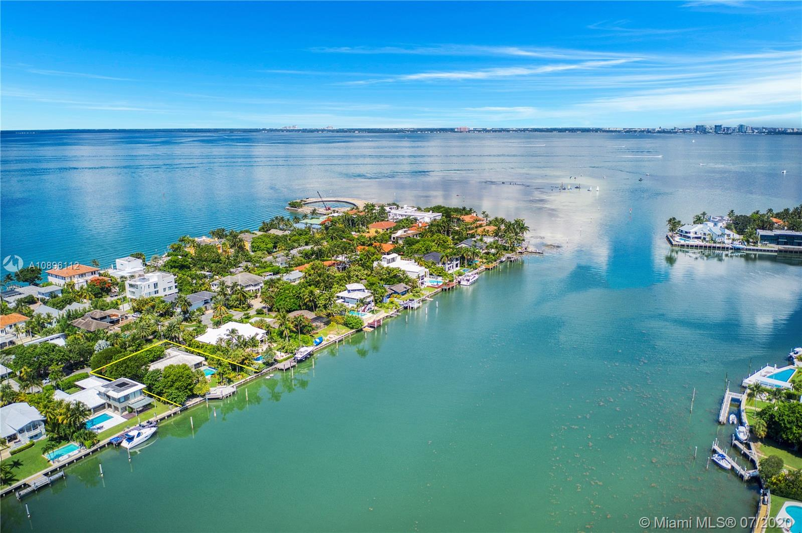 Charming waterfront home with 4 bed, 4 bath plus staff quarters.  Overlooking Key Biscayne's Hurricane Harbor.  15,080 lot with 104 feet of water frontage. Great location for boat enthusiast.  Situated on the widest part of the protected harbor features boat Davits and an oversized dock.  Fantastic opportunity to transform this spacious home or build a tropical dream home on North Mashta Island. Living areas include two dens, separate dining and living room. Exterior features include covered patio, heated swimming pool. Full house generator included in sale.