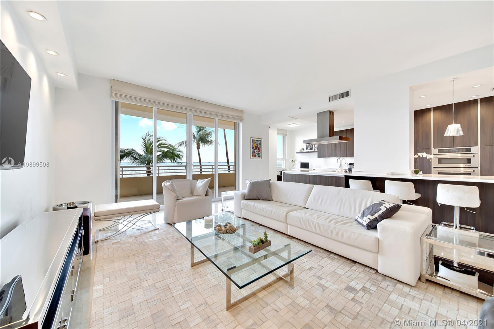 Enjoy the best lifestyle in the exclusive island of Brickell Key at the most iconic tower, Two Tequesta. This chic, modern and spacious unit is on the premium line, it's got breathtaking ocean views & it's been tastefully renovated in '17. Park on the 2nd floor & walk straight into your home, no elevators needed. It's like living in a house but with the security and amenities of a 5 stars resort. There's only 8 units per floor. It features, 2 parking spots, Jenn-Air and Sub-Zero appliances, all marble floors, impact windows, hurricane shutters, double entry doors, high ceilings, spectacular open kitchen, and a large storage room. The updated amenities include 2 top of the line bbqs, pool with enclosed cabanas, kids area, state of the art gym, racquetball and basketball courts & yoga room.