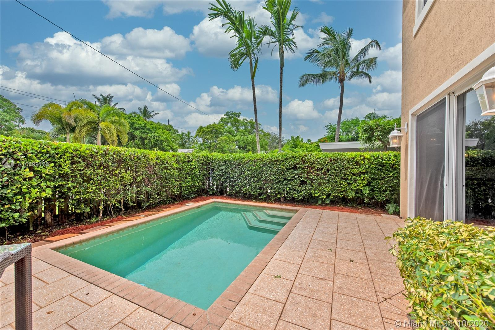 Beautiful and Spacious Townhome w/ private Pool.. Feels like living in a Single Family Home. Completely fenced and private yard. Hurricane Impact Windows/Doors. Bright open floor plan with soaring ceilings. Gourmet Kitchen, Walk-in Pantry, Stainless Steel Appliances (including Wine Fridge), Granite Counter top. Custom dry bar. Large and Bright Master Bedroom w/full Dual Custom Walk-in Closets. Beautiful Solid Mahogany Wood Flooring. Upstairs Laundry. Open Balconies. Custom Lighting & Window Treatments. AV Wired Surround Sound System. 2 Car Garage opens to Brick Pavers Driveway. Brand New A/C (2020 with 10 year warranty) NO HOA!  Walking distance from Holiday Park in Victoria Park, 2 miles from the Beach, 1.5 mile from Las Olas, Restaurants and Shops!