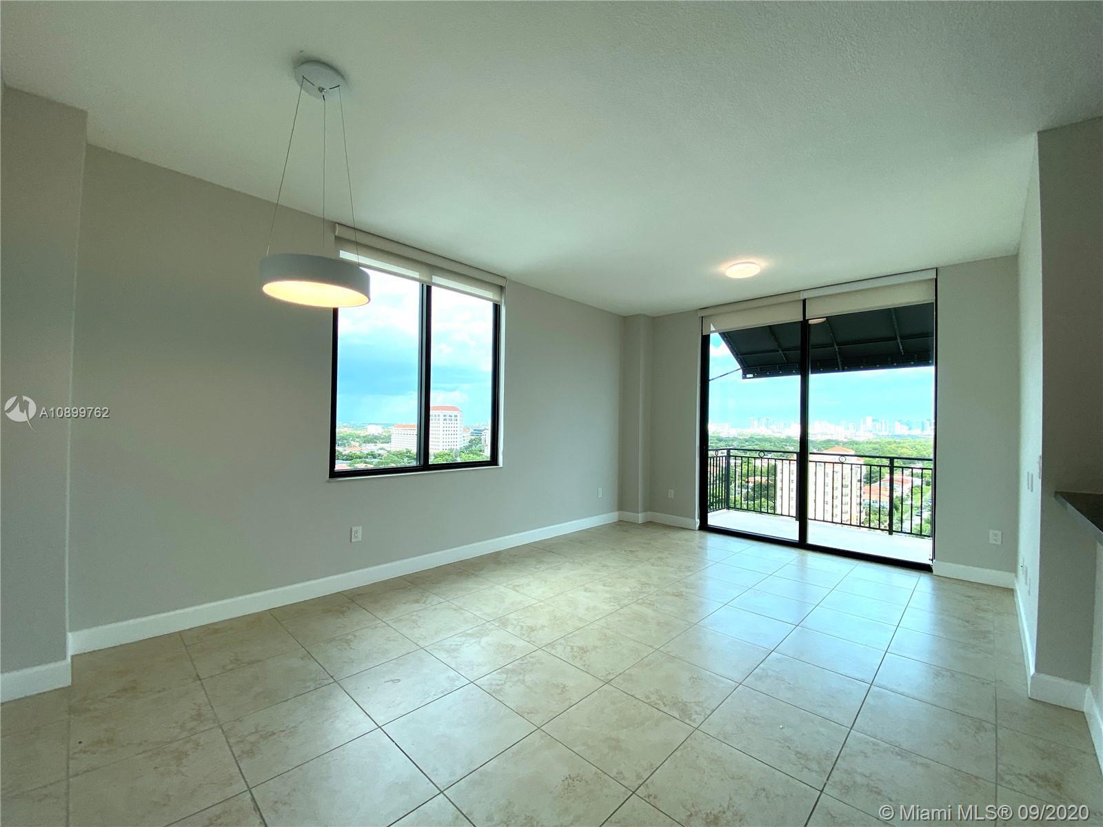 Unique corner Penthouse Unit at luxurious 1300 Ponce. This is a 2bed 2.5 bathroom with DOUBLE HEIGHT CEILINGS as well as double balconies featuring unbeatable views east of downtown and south/ west of the Gables. Each bedroom has its own ensuite bathroom with dual sinks and separate tub & shower. Unit also includes high end granite countertops, italian cabinets and walk-in closets as well as stainless steel appliances. 2 assigned parking spaces included too. Building is full of state of the art amenities including a massive pool and wet deck, modern gym, event room and more.. all located just blocks from all the great dining and shopping in Miracle Mile! Ready to move in and live!