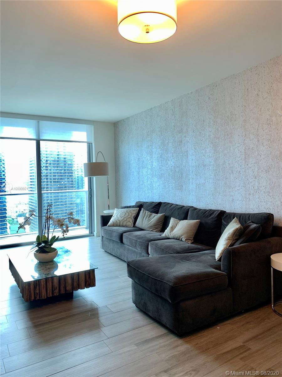 """Beautifully Furnished 1 bedroom in Millecento with gorgeous views from the 33rd floor.  Unit features King Size bed, L-shaped sofa with pull out bed, modern desk, kitchen is fully equipped.  All """"like new"""" grey wood/tile flooring. Spacious bathroom with shower and separate bathtub.  Master bedroom has large walk in closet, hallway has a linen closet and the kitchen has a washer/Dryer closet with space for storage.  Balcony extends from living room to bedroom.  Roller shade in the living room and bedroom plus black out shades in bedroom.  Clean and ready to move in!"""