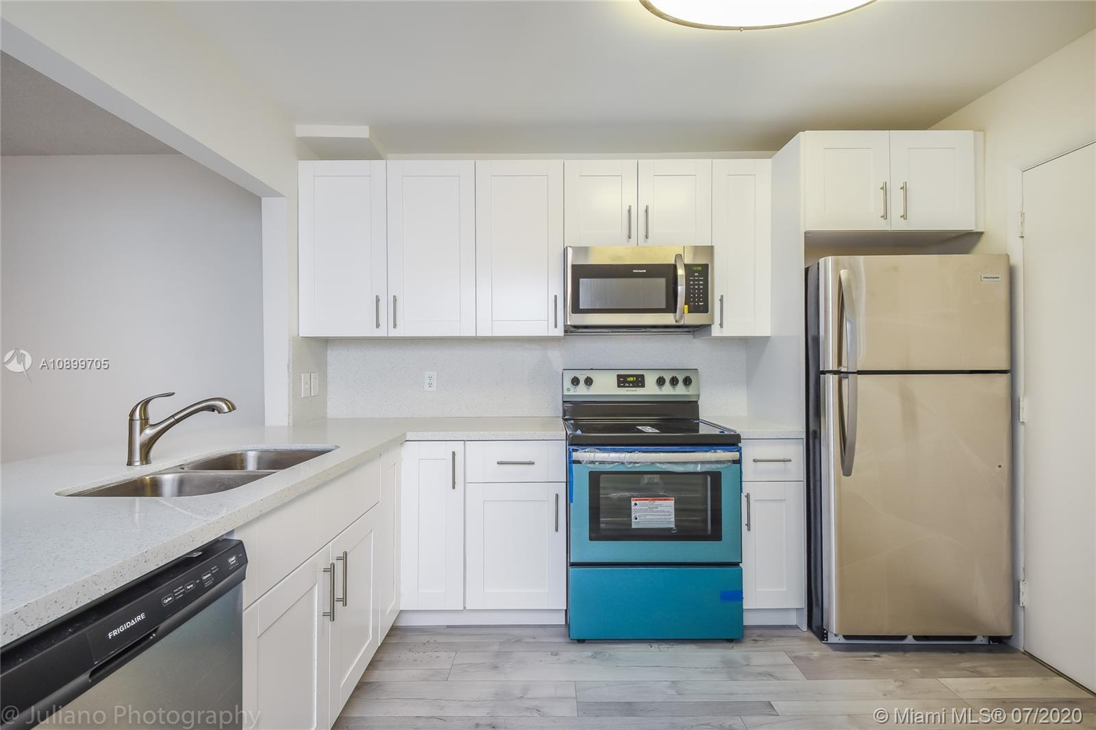 BEAUTIFUL FRIST FLOOR CORNER CONDO. PARKING IN FRONT OF THE CONDO. VERY SPACIOUS EAT-IN- KITCHEN. GREAT FLOOR PLAN. CERAMIC TILE THROUGH OUT. SCREEN ENCLOSED PATIO. LARGE LIVING AND DINNING AREA. LOTS OF CLOSET SPACE. ALL AGES WELCOME. OWNER IS VERY MOTIVATED.FULLY RENOVATED 1 YEAR AGO, NEW APPLIANCES, FLOOR , NEW MODERN KITCHEN.