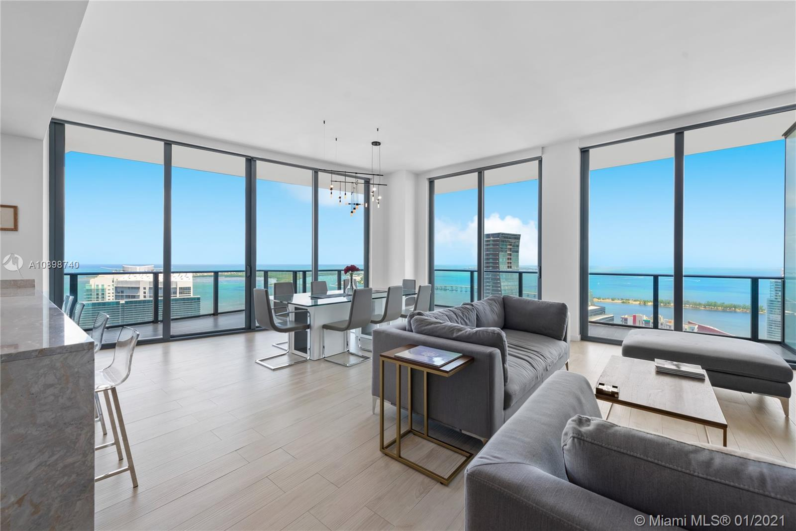 This meticulously renovated 3bed/3.5bath Penthouse uses its space to its utmost potential and is intricately designed for those who live their lives with an inherent sense of style and sophistication. Penthouse 5205 offers incredibly unobstructed views from East to Miami Beach and South to The Keys. The oversized Owner's suite features a sleeping and sitting area and large walk-in closet. Scenes of the bay, ocean, Miami Beach, and Coconut Grove can be enjoyed from the wrap-around balcony. Includes 2 garage spaces on the 1st level of parking and an extra large storage area. With Outstanding amenities such as a rooftop pool, gym, spa, billiard room, private theatre, kids' room, party room, World class Fi'Lia restaurant and Saam bar, SLS at Brickell paints the details of a life well-lived.