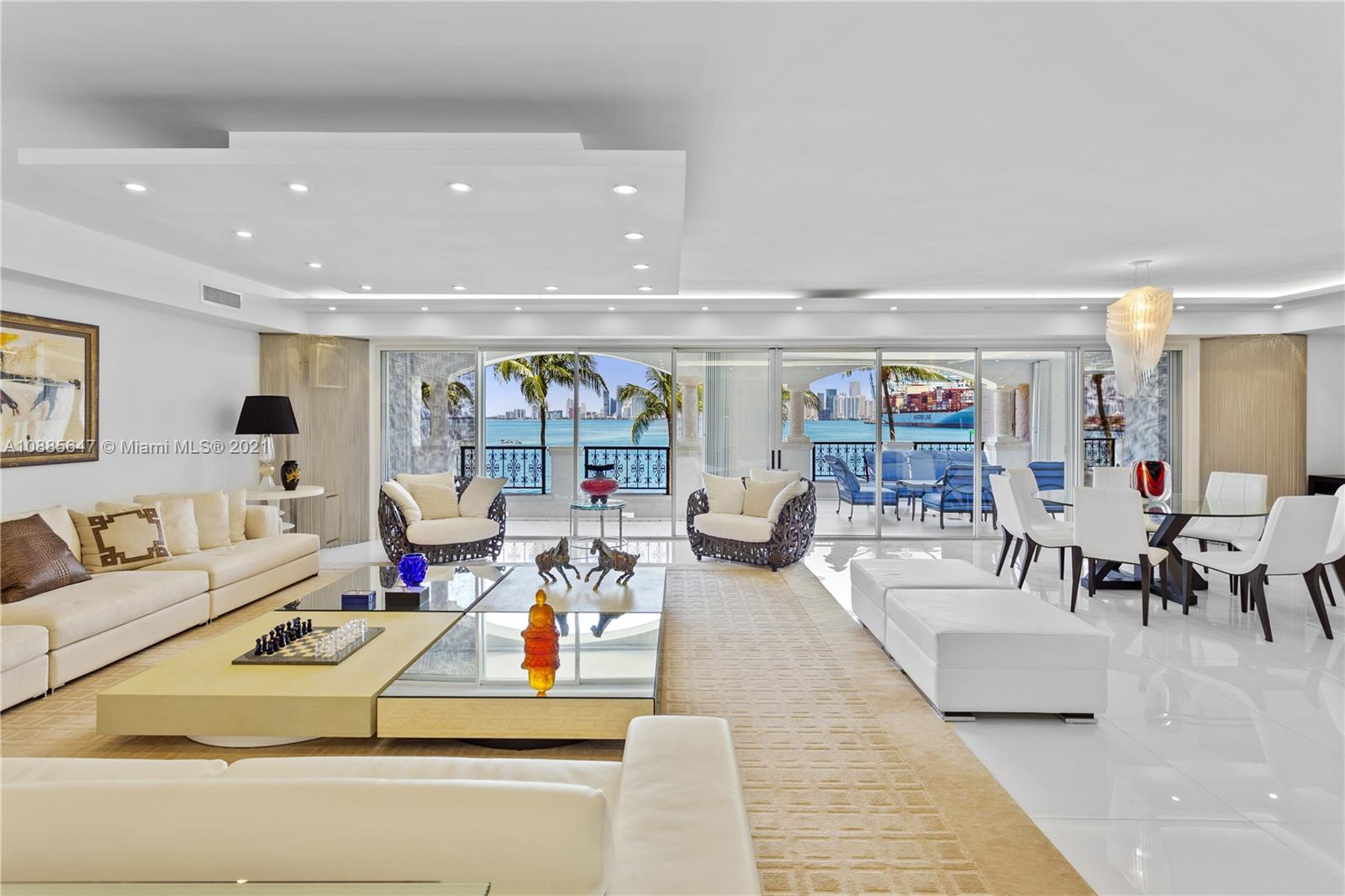 FISHER ISLAND'S BEST VALUE FOR SPRAWLING FAMILY CONDO WITH DIRECT DOWNTOWN MIAMI VIEWS & MAGICAL SUNSETS DRAPING OVER THE BAY! White Finish Living Room w/ Bay Views. Fully Renovated Unit w/ 9FT in 6,300 Interior SF + 1,500 SF Terraces. Converted into 4 Bed/4.5 Bath + Office w/ White Marble t/o. Family Room w/ Custom Lit Design Wall + 2 Dining Areas. Eat-in Chef's Kitchen Fully Equipped w/ Gas Stove, 2 Ovens, 2 Samsung Refrigerators, 3 Warming Drawers, 2 Kitchen Aid Dishwashers. Gold-Framed Wine Refrigerator for 240 Bottles. Bayfront Master w/ Seating Area + Private Terrace. Large Master Bath Wrapped in Cream Marble + His/Hers Closets. 3 Large Guest Rooms w/ En-Suite Baths & Large Terraces + Service Quarter's w/ Separate Entrance. 2 Car/1 Golf Cart Space + 2 Storage. SOLD W/ OUT MEMBERSHIP.