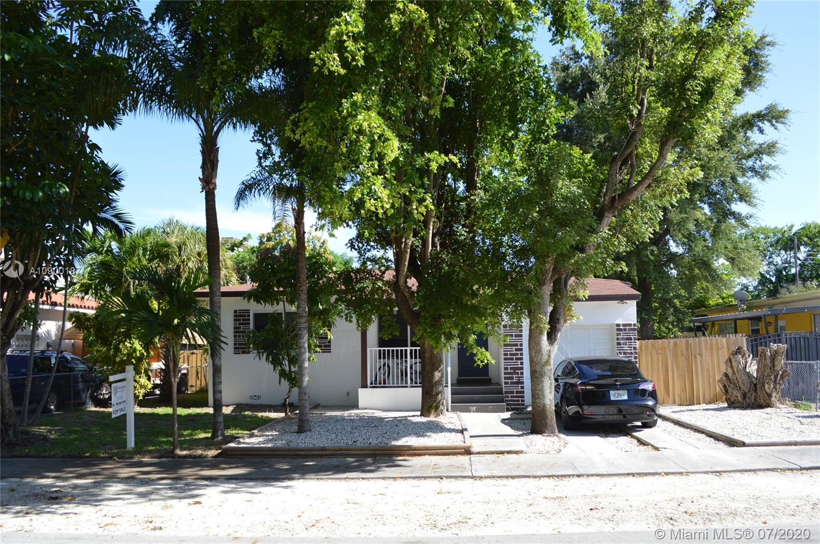 Beautiful house completely remodel 3 bedrooms and 2 bathrooms plus One car Garage. Centrally located between Coral Gables and Coconut Grove. The house is been updated from top to bottom. New roof, new appliances, impact windows, new A/C, tile and wood flooring throughout.