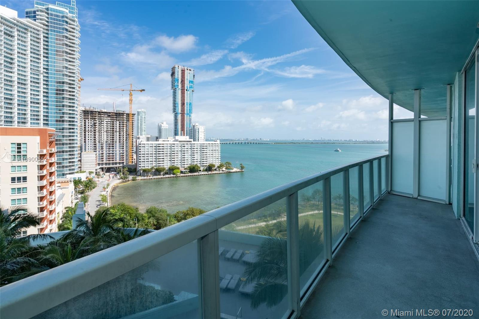 Wonderful 1 bedroom plus den and 1 bath unit with spectacular bay and city views. Nice laminated wood floors. S/S appliances. Building features 2 story lounge area, 2-story state of the fitness center, 2 pools, theater, 24-hour concierge. Across the street from Margaret Pace park. Minutes from S.Beach, Airport, Downtown Miami, Design District, and walking distance to carnival center, shops and restaurants.