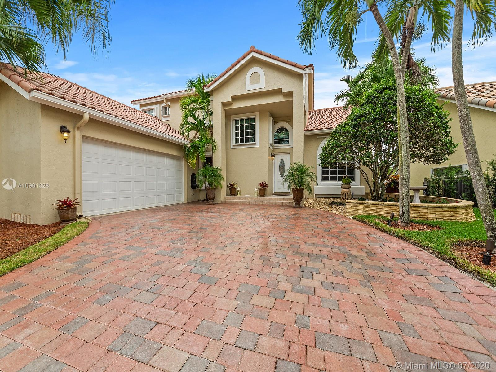 Can't miss this opportunity, enjoy living in this gated community with pool overlooking serene lake, clubhouse and playground! A+ school district and walking distance to Weston Town Center. Premium lot with water views and beautiful oversized screened in pool/patio area. Superbly maintained by original owners; copper plumbing, custom window treatments, custom closets, 2 car garage, newer AC & roof, marble & Brazilian hardwood flooring. Enjoy water views throughout the home, extended paved driveway and plush landscaping. Kitchen includes beautiful custom cabinetry with stainless steel appliances, granite counter tops, porcelain farmhouse sink and french doors with custom plantation shutters giving access to pool area.  Hurricane shutters installed. Do not miss out!