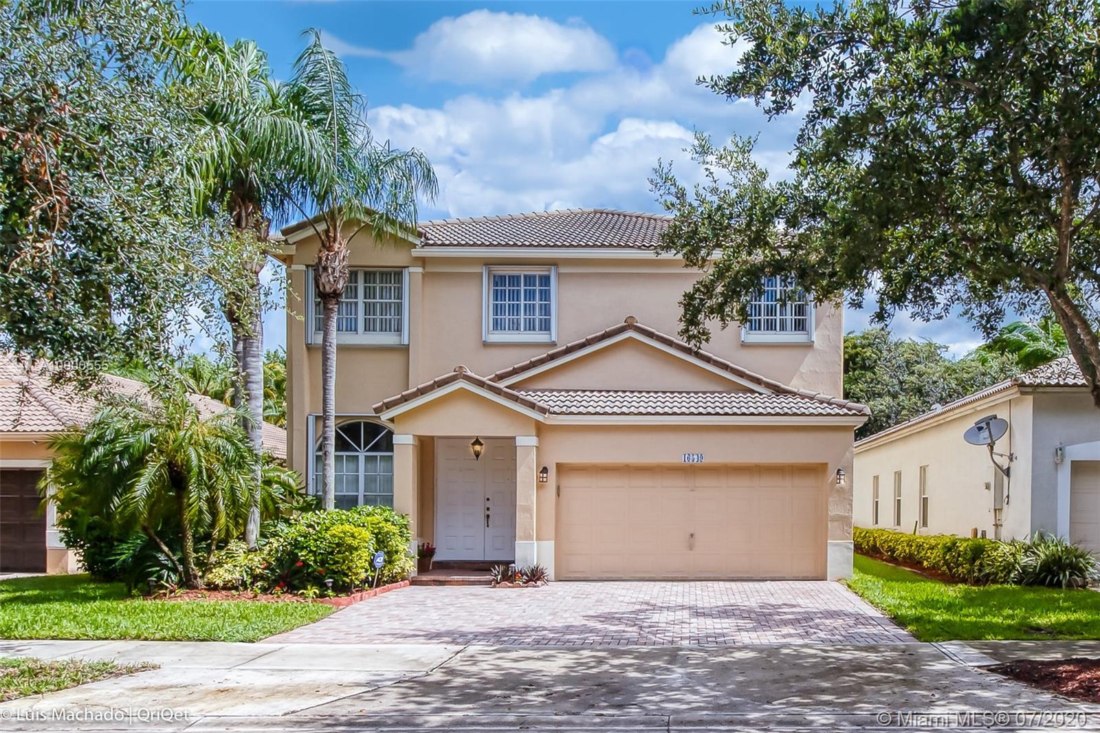MOVE IN READY & PRICED TO SELL! BEAUTIFUL,COMPLETELY REMODELED & EXPANDED HOME located in exclusive,GUARD GATED Emerald Estates at Weston! 4 Bedroom,4.5 Bath home,w/a flex room that can be used as 5th bedroom.3,381 SF under air & OVER $200K IN UPGRADES.Spacious formal living/dining rooms,updated kitchen w/hardwood cabinets,granite counters & S.S.appliances that joins another casual dining & family room overlooking the pool.20x20 porcelain tiles downstairs,Brazilian cherry wood upstairs.OVERSIZED M.Bedroom has sitting area and office.Huge patio w/ceiling fans,saltwater pool,water feature & travertine deck.Summer kitchen has a full cooking features,full sink & cabinets.This home is great for entertaining! All A+schools & close to shopping,City Park & I-75 for easy commutes.All ONLY $183/SF.!