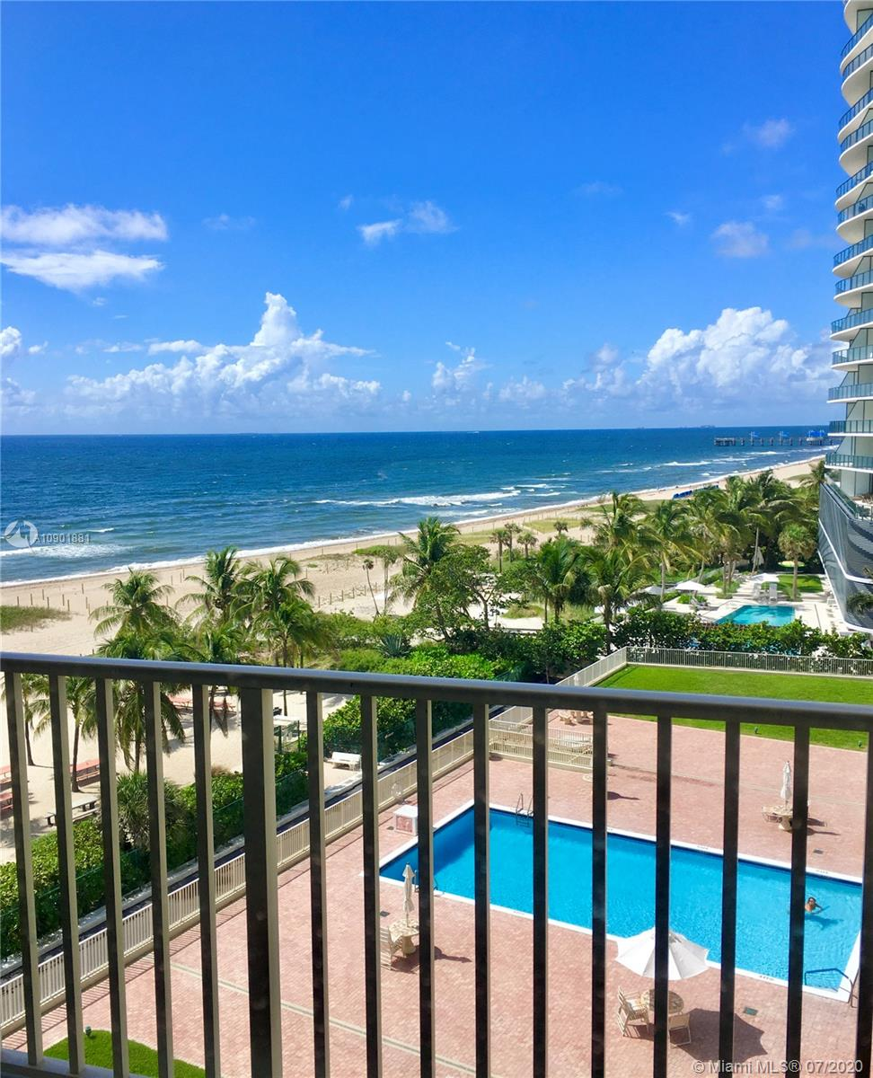Stunning beach and ocean views!!! Fully renovated 2/2 Condo in well managed building. Directly on the sand, this Condo includes private access to beach, garage parking, 24 hr security, lobby attendant, exercise room, beach-side heated pool, open balcony, barbecue and picnic tables for outdoor relaxation!  It is located very close to fine and casual dining, fishing pier, and terrific shopping. You'll love the beautiful open and upgraded eat in kitchen with stainless steel appliances and wood cabinets.  Unit also features impact windows and doors, except master bedroom window, marble floors and travertine bathrooms, bamboo/2 bedrooms, central vacuum cleaner, many closets, furniture included. Enjoy the ocean breeze from this absolutely turn key unit!!!