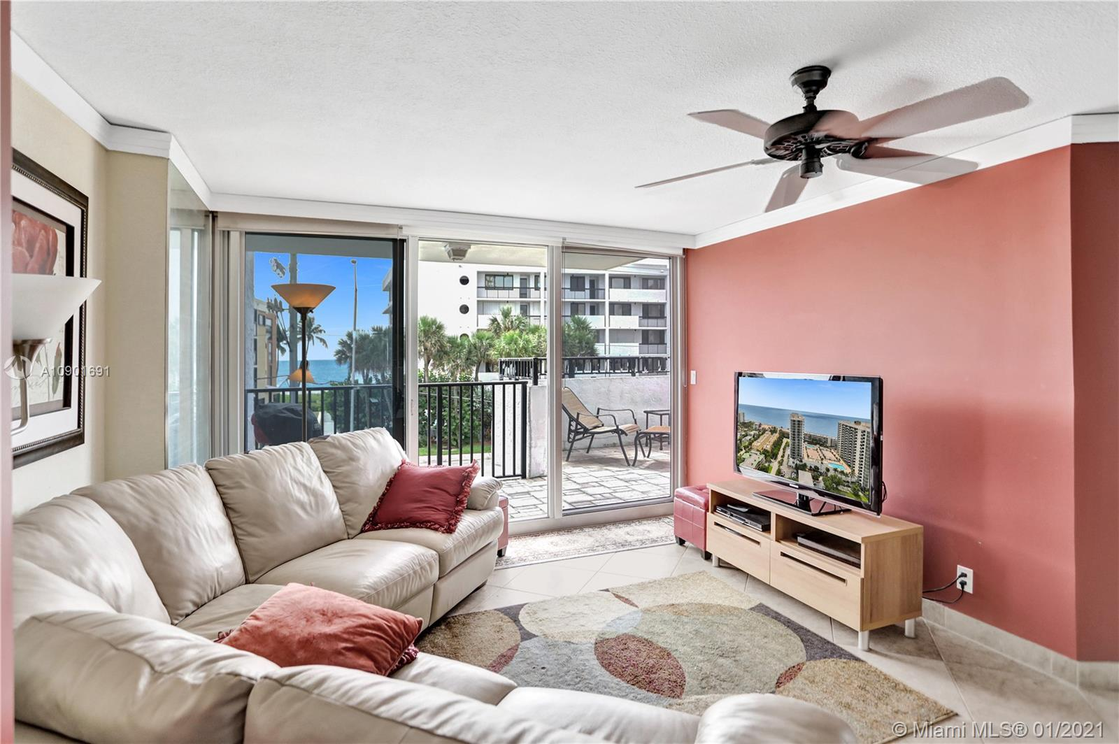 This ONE OF A KIND END UNIT LANAI features: DIRECT ocean views,  DIRECT OUTDOOR ACCESS FROM 5 hurricane impact sliding glass doors (1 from each room) to an OVERSIZED,WRAPAROUND PATIO w/room for BBQ, dining & relaxing (500+ sq ft), AND direct access to pool, tennis etc. Fully renovated w/ hi-end ss appliances, some electronic shades, tons of storage, open kitchen, split floor plan, avail TURNKEY. Bldg is across public beach w/easy access (see pics). Resort type living.  No rentals 1st year owned, but 90 day min lease 1 time per year thereafter. MUST SEE! This is a very special unit -- one of only two in the entire complex.