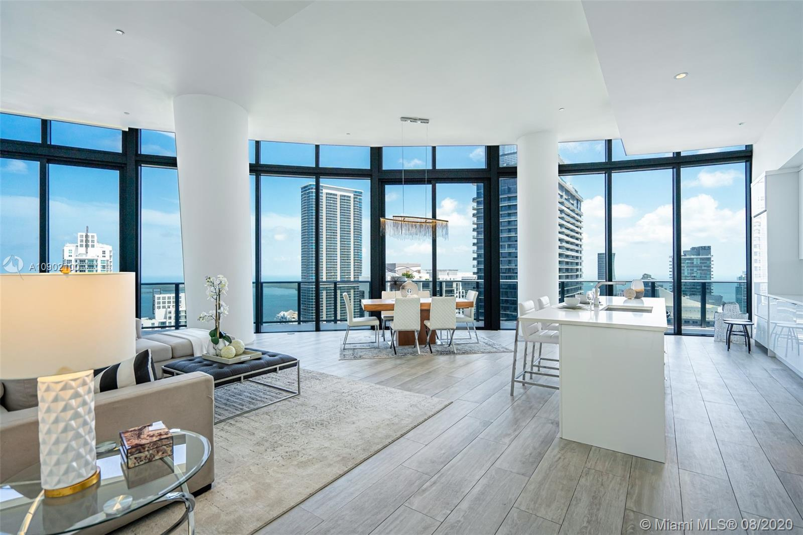 Sleek and modern penthouse unit that delivers 5 star resort style living. Spectacular view of the city and Biscayne Bay from the wrap around balcony. The unit is 3 bedrooms, 4 baths with a den and is 2,228 square feet. The kitchen has all top of the line appliances including a sub-zero fridge.  Brickell Heights is the place to be in this up and coming neighborhood! Offering 24/7 valet service, 2 parking spaces, a rooftop Sky Deck Pool, an engaging kids club with activities, Equinox Fitness Club & Spa along with Soul Cycle cycling studio is on the first floor. Conveniently located within walking distance of shopping.