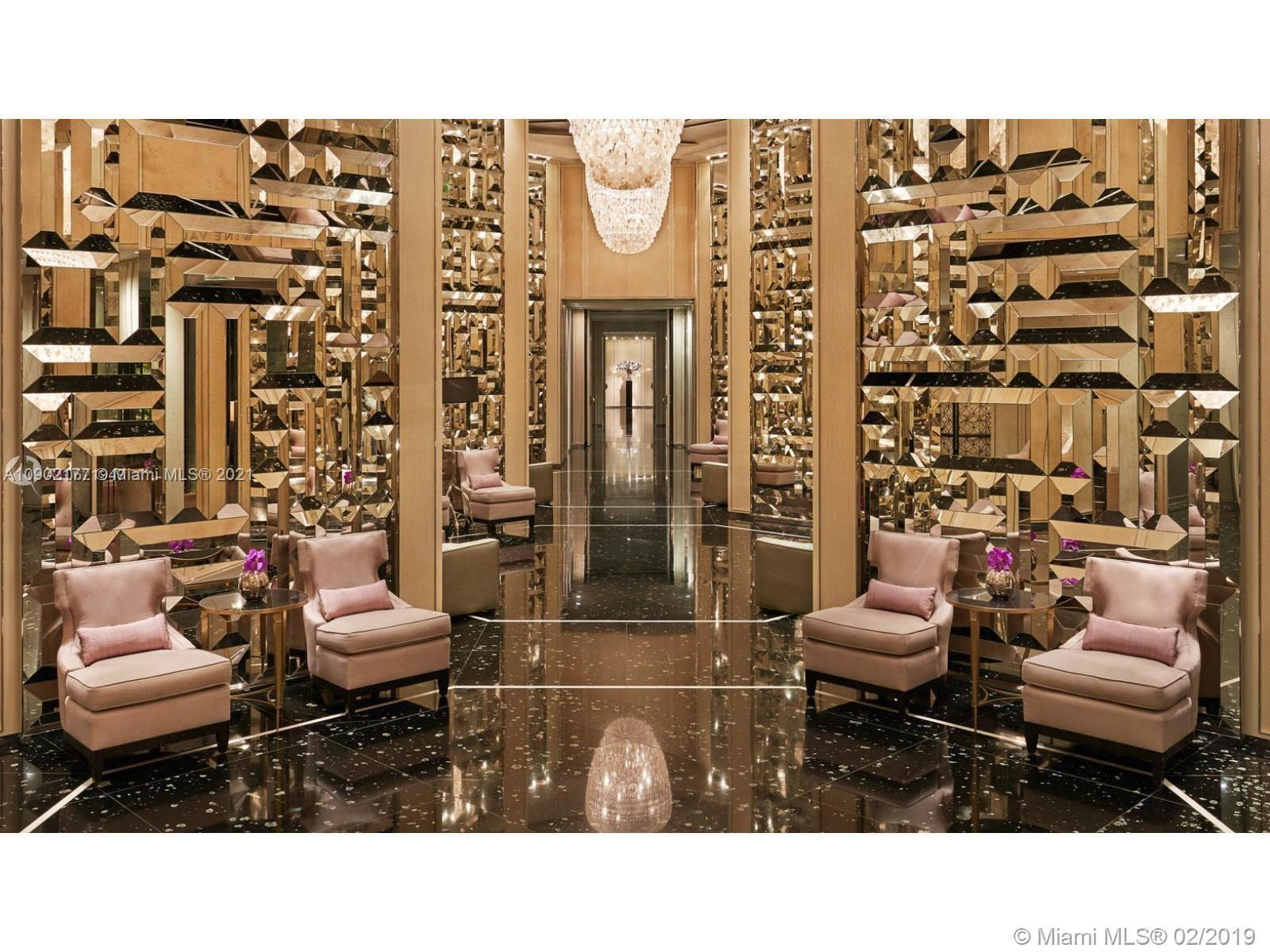 Welcome to the luxury life of the famous St Regis. Fully furnished, equipped and decorated by the world known Yabu Pushelberg. 1 bedroom plus den, which is converted to the second bedroom, 2 full large marble bathrooms. Square footage along with two enormous terrasses is 1475 sq feet. Unobstructed ocean view with the desirable northeast exposure. Enjoy all the 5 star resort amenities St Regis may offer. 2 gourmet restaurants, state of art Spa and fitness center, butler, concierge, two infinity  pools and beach services. Cross the street from the well known Bal Harbour shops.
