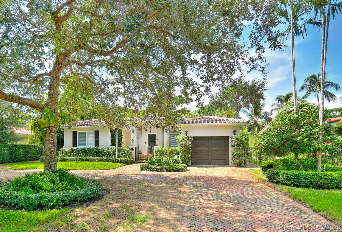 This spectacular graceful smart-home has it all – boundless beauty & all of today's conveniences on a wonderful South Gables street. Impact windows & doors, gorgeous updated kitch, huge luxurious master suite & so much more! Gorgeous plantation shutters on all windows, hardwood flrs, vaulted wood-beamed ceilings, spacious bedrooms, awesome laundry rm, light & bright spaces. The kitch opens to the inviting, bright fam rm & passes through to the formal din & liv rms. The HUGE master suite has 2 closets and a big, comfortable bathrm w private water closet. A sparkling new pool & brick patio in back are the centerpiece for the summer. The pool is both heated AND air conditioned-it's a Miami dream come true! Enjoy a new summer kitch complete w built in Green Egg, gas BBQ, ice chest & fridge.