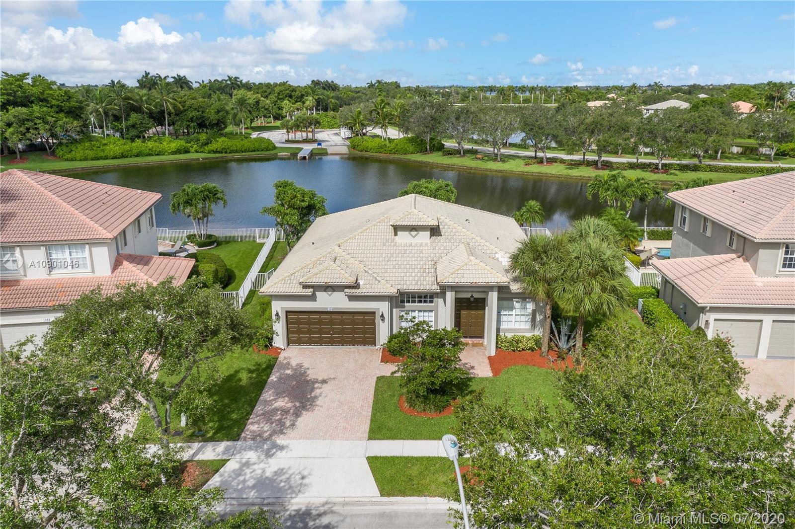 """***STUNNING***RENOVATED***LAKEFRONT***ANASTASIA MODEL HOME***BREAKERS at PEMBROKE ISLES** Contemporary Remodeled Kitchen, Quartz Countertops, Stainless Steel Appliances, Wine Service, Serving Bar, Spacious Master Suite, His & Hers Walk-in Closets, Dual Vanities, Roman Tub, Modern Vinyl Plank Flooring, Custom Lighting, Expansive Covered Patio, Fenced Grounds ***TRANQUIL WIDE LAKE VIEWS*** Residents of Pembroke Isles Enjoy: Fitness Center, Aerobics, Sauna, Tennis, Racquetball, Basketball, Soccer, Beach Volleyball, Swimming Pools, Jacuzzis, Fishing Piers, Walking/Biking Trails, Covered Picnic Areas and Children's Playgrounds.  HOA Includes: Security, Landscaping, Cable, Internet & Alarm Monitoring.  Convenient to Shopping, Dining, Travel and """"A"""" Rated Schools."""