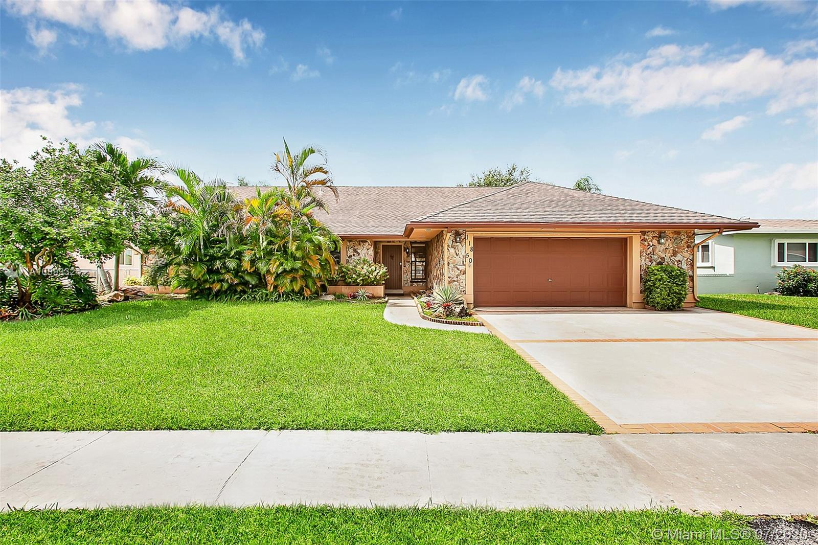 LAKEFRONT home in desirable Pembroke Lakes neighborhood with no HOA! Huge 14,000+ sf fully fenced lakefront lot! Enjoy the spectacular sunsets while relaxing on the lighted deck and gazebo on the water. Screened in patio with hot tub offers the perfect setting to enjoy outdoor dining and entertaining. Step inside and you will love the spacious 4 bedroom 2 bath, 2 car garage home. Open concept living area with tongue and groove vaulted ceilings*neutral tile floors*updated kitchen featuring wood cabinets*granite counters*SS appliances with gas cooking, and large, complete wet bar with granite counters and lots of cabinets. Both bathrooms have been beautifully updated with granite and frameless shower doors. Located only minutes to Memorial Hospital West & loads of shopping and entertainment.
