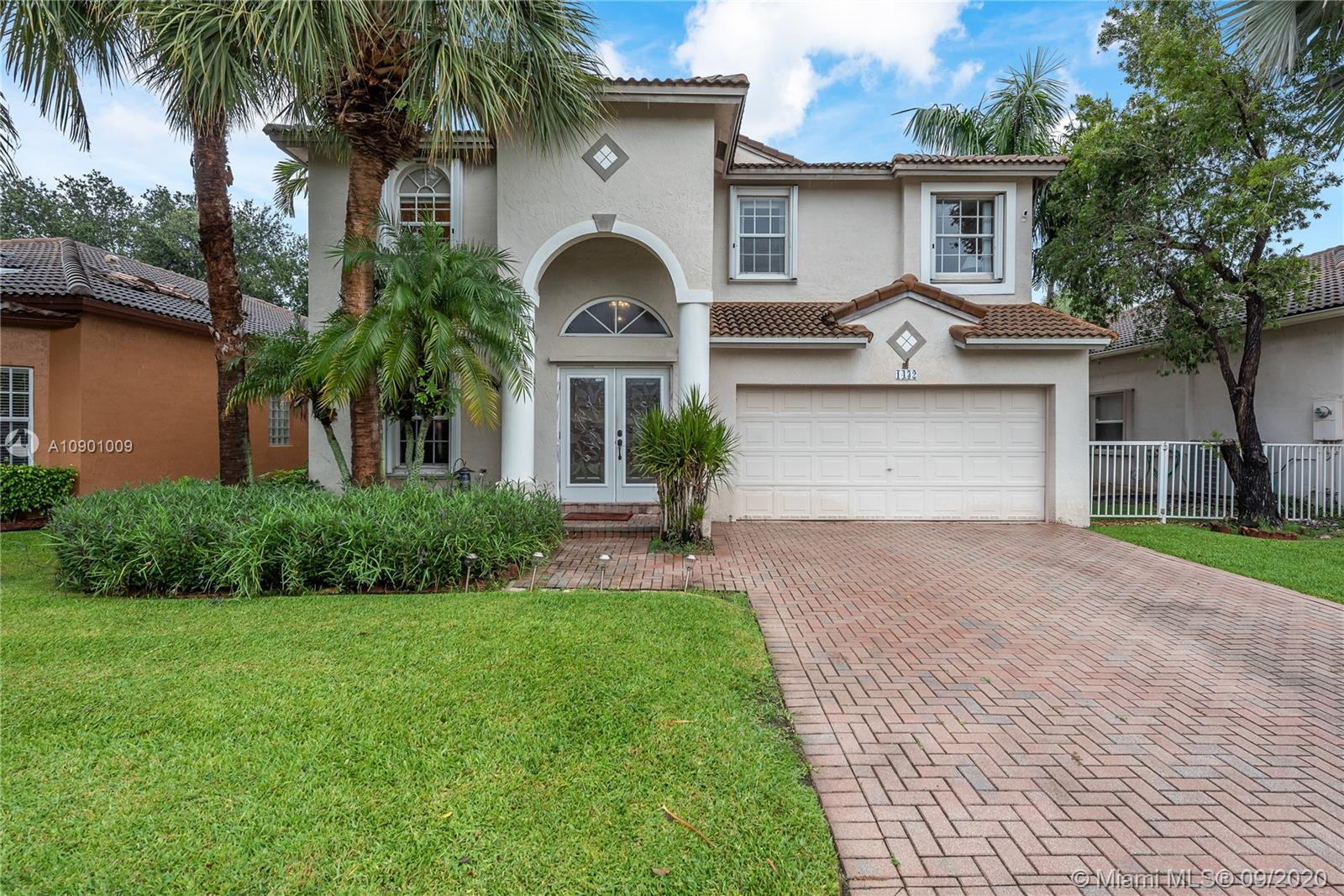 Grand opportunity in Grand Palms! This spacious and true 5 bedroom (all upstairs) 3 full bath with almost 3000sqft of living area space features an open kitchen with granite counters, pantry, and breakfast areas that overlooks the pool. The primary suite provides access to a separately screened-in balcony, tray ceiling, and a bath with dual vanities and separate Roman tub / shower. Additional features include tile flooring throughout, volume ceilings, crown molding, accordion shutter protection, and a partially covered- screened-in patio with a heated POOL. Grand palms is a guard gated GOLF community that is conveniently located near I-75, parks, schools, restaurants, and shopping.