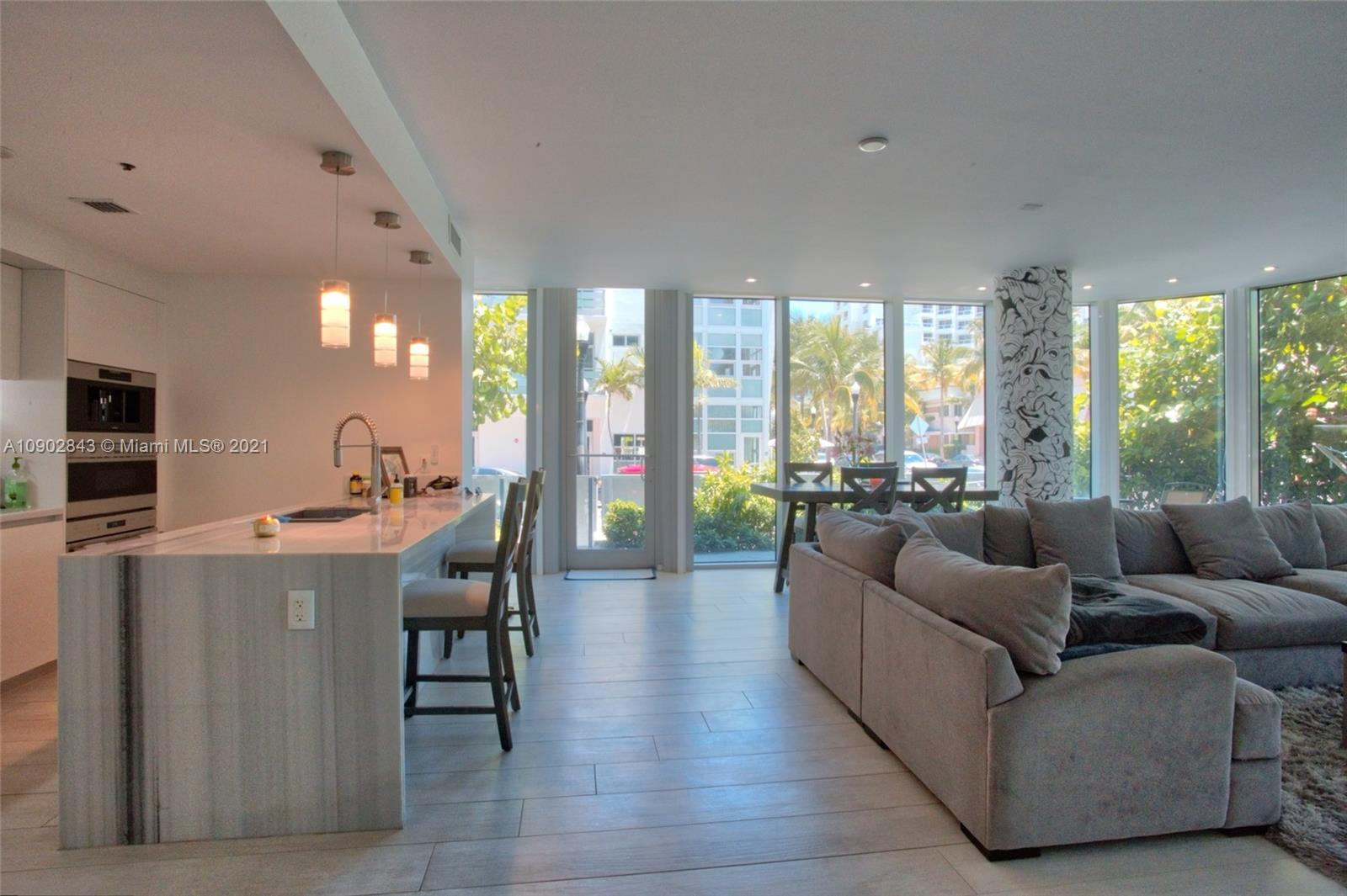 UNIQUE and EXCLUSIVE LANAI, 12 FOOT CEILINGS. A must-see impeccable corner unit. Feels like a residence but with all the amenities and services of a condo. The private garden wraps around the unit with ample space for outdoor living areas in an enclosed gated private garden. The condo has 2 entrances, one from the building lobby & A Private entrance from 1st street and Ocean Drive gated door. Spacious 2 beds/2.5 bath Corner residence with over 1,790 sq ft. Walk to all the best restaurants and nightlife of South of Fifth. Amenities include an infinity-edge pool deck, state-of-the-art fitness center, an outdoor clubhouse, a zen park, exclusive Private Beach Club membership at the Bentley Beach, and 24-hour on-site concierge service. Amazing OPEN Kitchen with GAS Stove.    Easy to Show!!