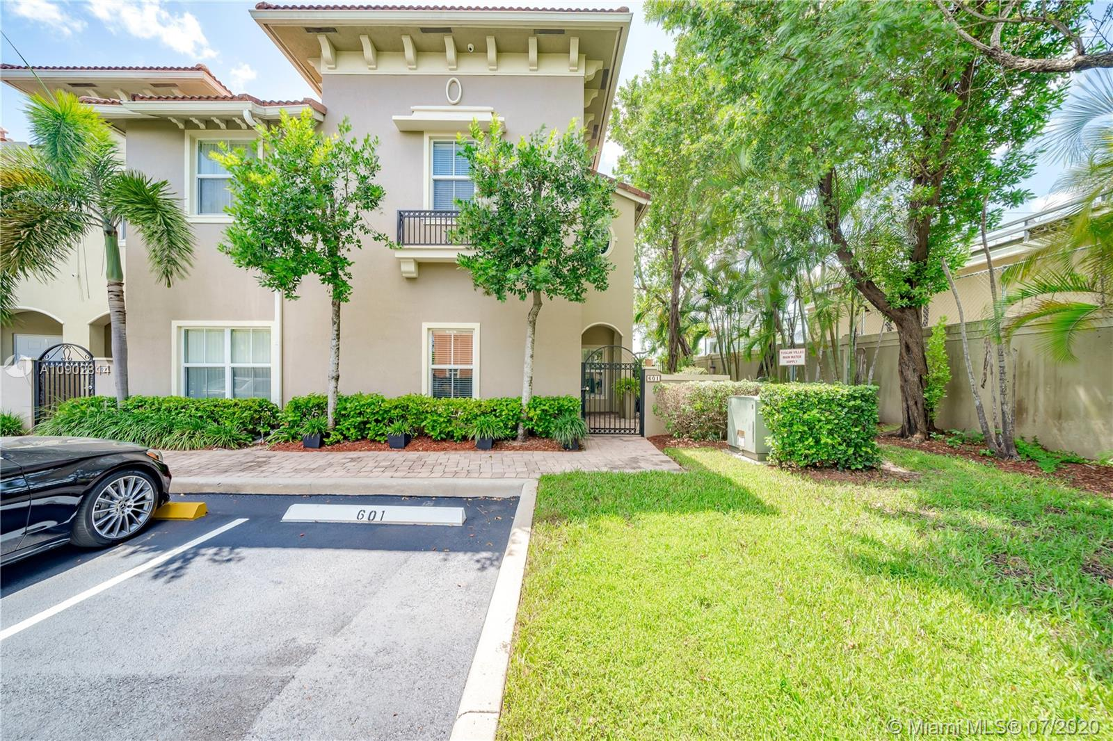 """Gorgeous corner unit townhome w/3 bedroom 3 bath plus loft in the gated community of Tuscan Villas!! Impact glass windows/doors throughout! Built-in 2008. Large kitchen with wood cabinetry (42""""), granite countertops & stainless steel appliances. Washer/dryer purchased new in 2014 and kitchen appliances purchased new in 2017.  Tile flooring in main living areas. Crown molding, deep baseboards & tons of natural light. First floor has 1 bedroom & full bath. Both bedrooms upstairs have on-suite baths. Master has walk-in closet & bath features double vanity, framed mirror & shower/tub. Large loft upstairs great for office/den. Fantastic community w/gate & pool. HOA fee covers insurance, roof repairs, water, cable & so much more! Property is in immaculate condition!"""