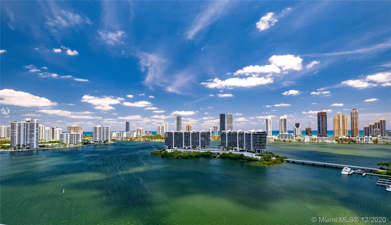 Nested at PRIVE Condominium on PRIVE Island, where privacy & elegance come together. 504N is a fantastic flow-through unit with private elevators & foyer, 2bedrooms/2.5bath, 2 balconies, 1 parking space, 1 storage room in garage. Unobstructed intracoastal, ocean and city views.. Exclusive lifestyle amenities include 2 outdoor heated pools, tennis courts, wine & cigar rooms, library & party rooms, Spa, state of the art Gym, Cafe, children & teen's room & more. Unit is finished with PORCELAIN FLOORS throughout, built-in wooden CLOSETS & electric BLINDS. PLEASE CLICK ON VIRTUAL TOUR!!