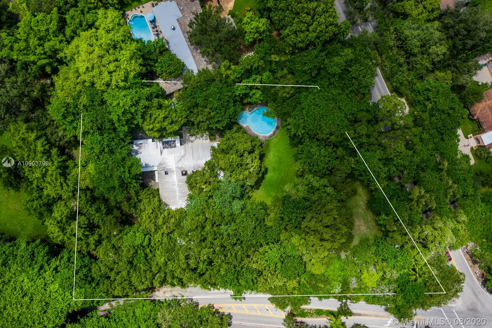 Prime opportunity to own over 1.55 acres in one of the most coveted areas of Coral Gables. Sprawling green land surrounds the existing home, together with natural coral rock on the property. Walled property, Mature oaks and trees allows for ultimate privacy in the midst of it all. Owner occupied, Easy to show.