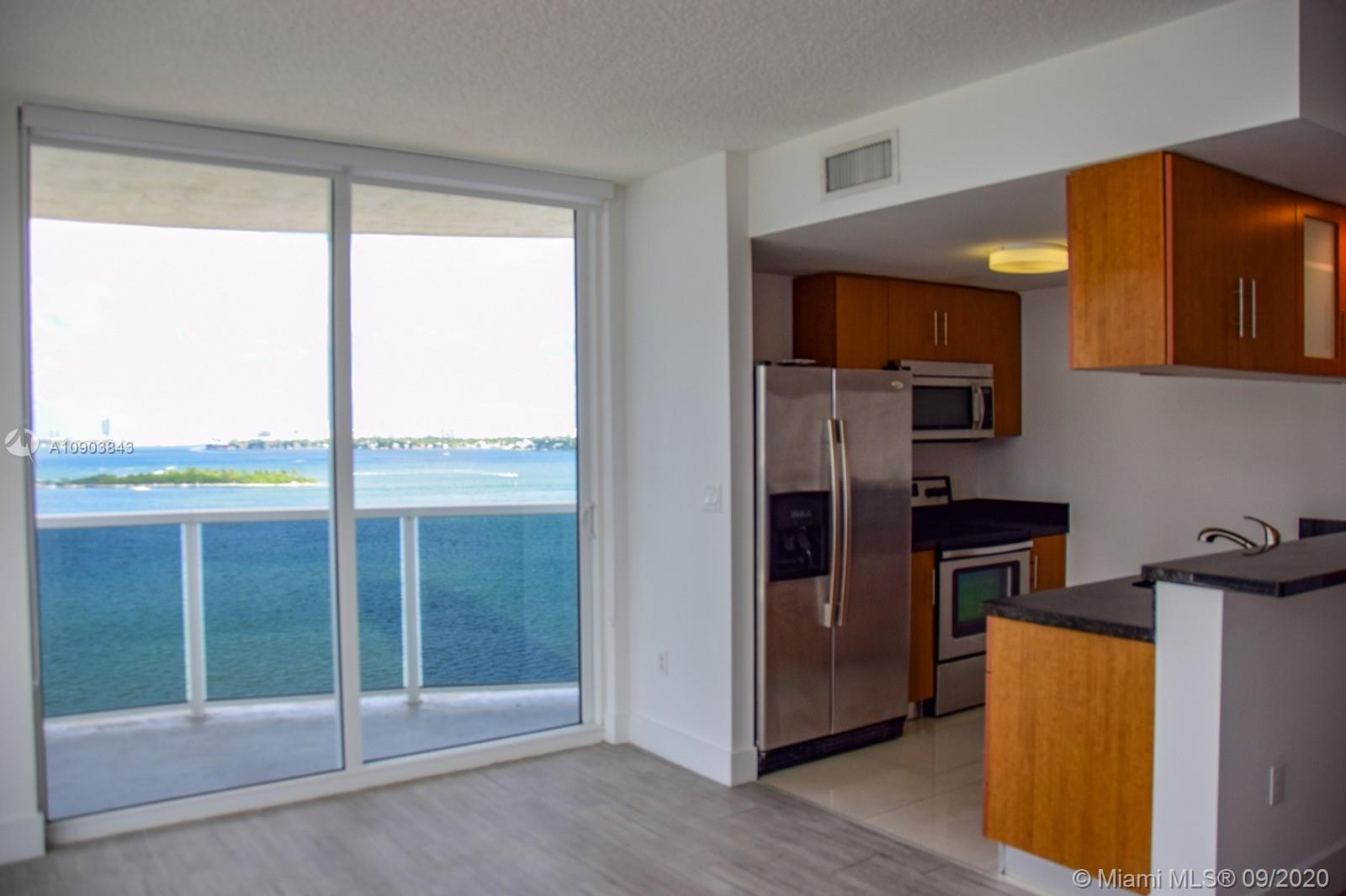 BREATHTAKING VIEWS OF BISCAYNE BAY, STAINLESS STEEL APPLIANCES, STACKABLE WASHER AND DRYER. POLISHED GRANITE COUNTERTOPS AND ITALIAN STYLE CABINETRY.