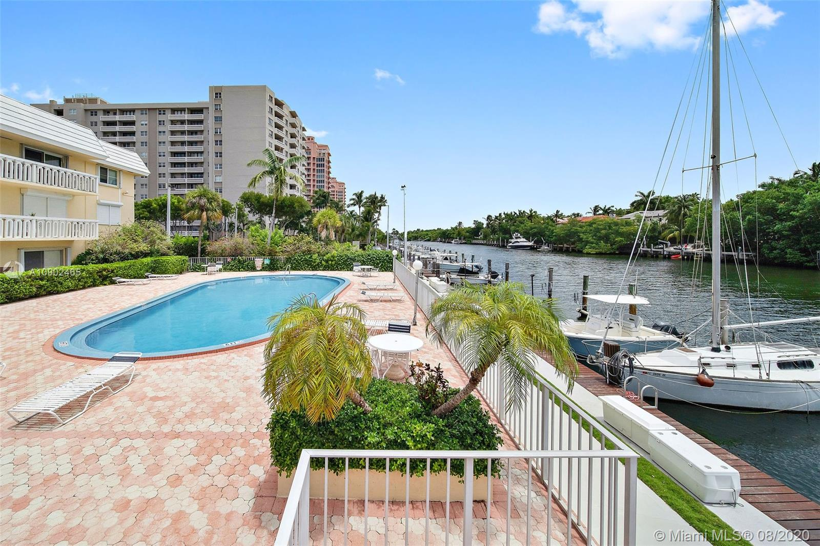 "REDUCED! Waterfront Condo! Completely Remodeled! New Kitchen with Stainless Steel Appliances, Hardwood Floors throughout, New Bathrooms! Overlooking the Coral Gables Waterway, Boat Dock & Pool. 1 bed / 2 bath (888 sqft) condo is a gem! Large Walk-in Closets, tons of storage! Located on the first floor, this Condo feels like a house! Parking is steps to the condo. You can be ""Socially Distanced"" and go directly from the car to your condo without using elevators or seeing neighbors. Low Maintenance! Charming building on Exclusive Edgewater Drive in the heart of Coral Gables. Check out our virtual tour for a walkthrough of the property! Easy to Show!"