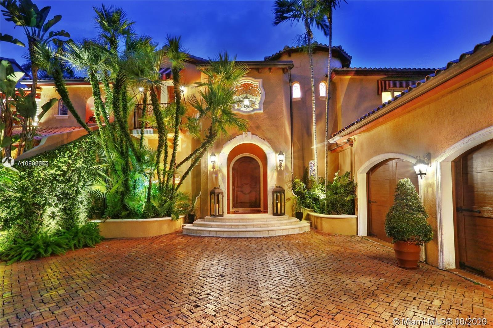 Stunning Spanish Villa - A rare opportunity to enjoy the exclusive guarded/gated Hammock Oaks with double slips w/75' boat dock in marina,ocean access to Biscayne Bay! Distinctive architectural design with timeless grace and elegance. High ceilings,marble & wood flooring. Utmost attention to exquisite details.Extraordinary mill work & authentic Spanish stone/tile accents. Lovingly cared for & updated to perfection!Formal living & dining.Newly renovated gourmet chef's dream kitchen with all top of line appliances.Family/media room w/state of art audio/video systems.Wine cellar, full bar. All new baths! Lavish master suite w/ balcony and beautiful vistas!!Gorgeous landscaping, Large exterior patio/gazebo with built-in grill. Sports court. 3 car-garage w/car lift. A magnificent masterpiece!!