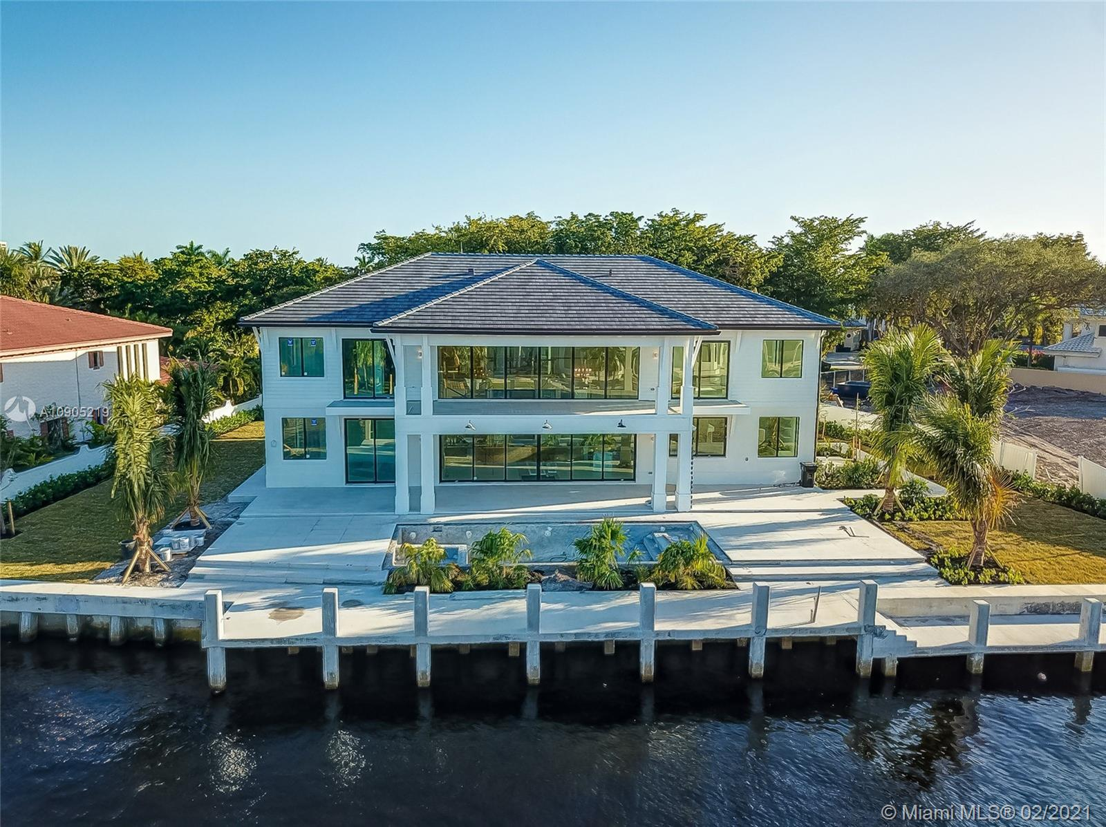 New construction home located within one of the only private, 24 hour guard gated community in Fort Lauderdale known as Bay Colony. This home sits on an oversized waterfront lot featuring 6 bedrooms plus flex room and 5.5 bathrooms. Custom chefs kitchen and lavish bathrooms by Mia Cucina. Open floor plan with 22ft ceilings perfect for entertainment and hosting friends and family. Boaters dream with no fixed bridges and easy access to open waterways. 110' dock, 10' wide, and 151' of Seawall. Completion estimated Q4 2020.