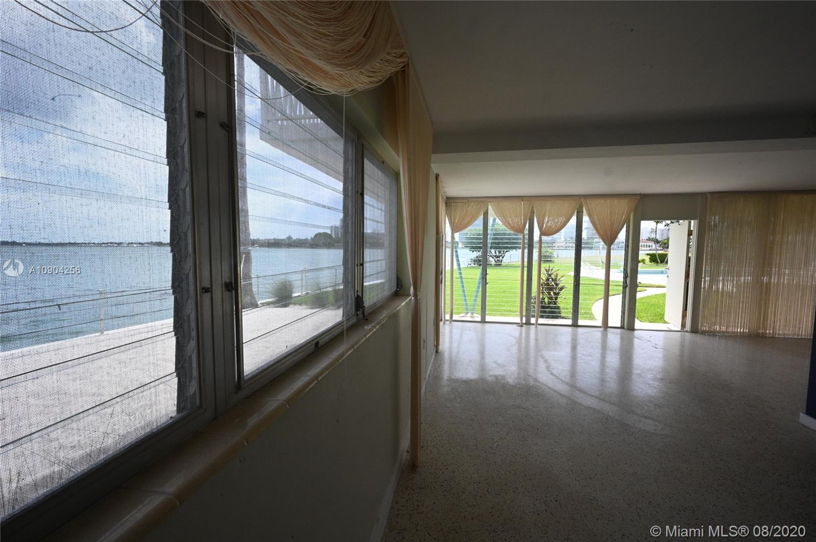 Great Mid-Century master piece building. Gran floor corner unit,25 feet facing the wide Bay, terrazzo floor, central A/C and floor-to-ceiling windows. Enjoy a heated swimming pool with, dock, white sandy beach, shuffleboard and kayak storage and barbeque areaWaking distance to fine dinning, beaches, Bal Harbor Shops, Houses of Worship and Rated school K-8Yes,this is Dexter building, excellent life style. Call or text listing agent for showing instructions.