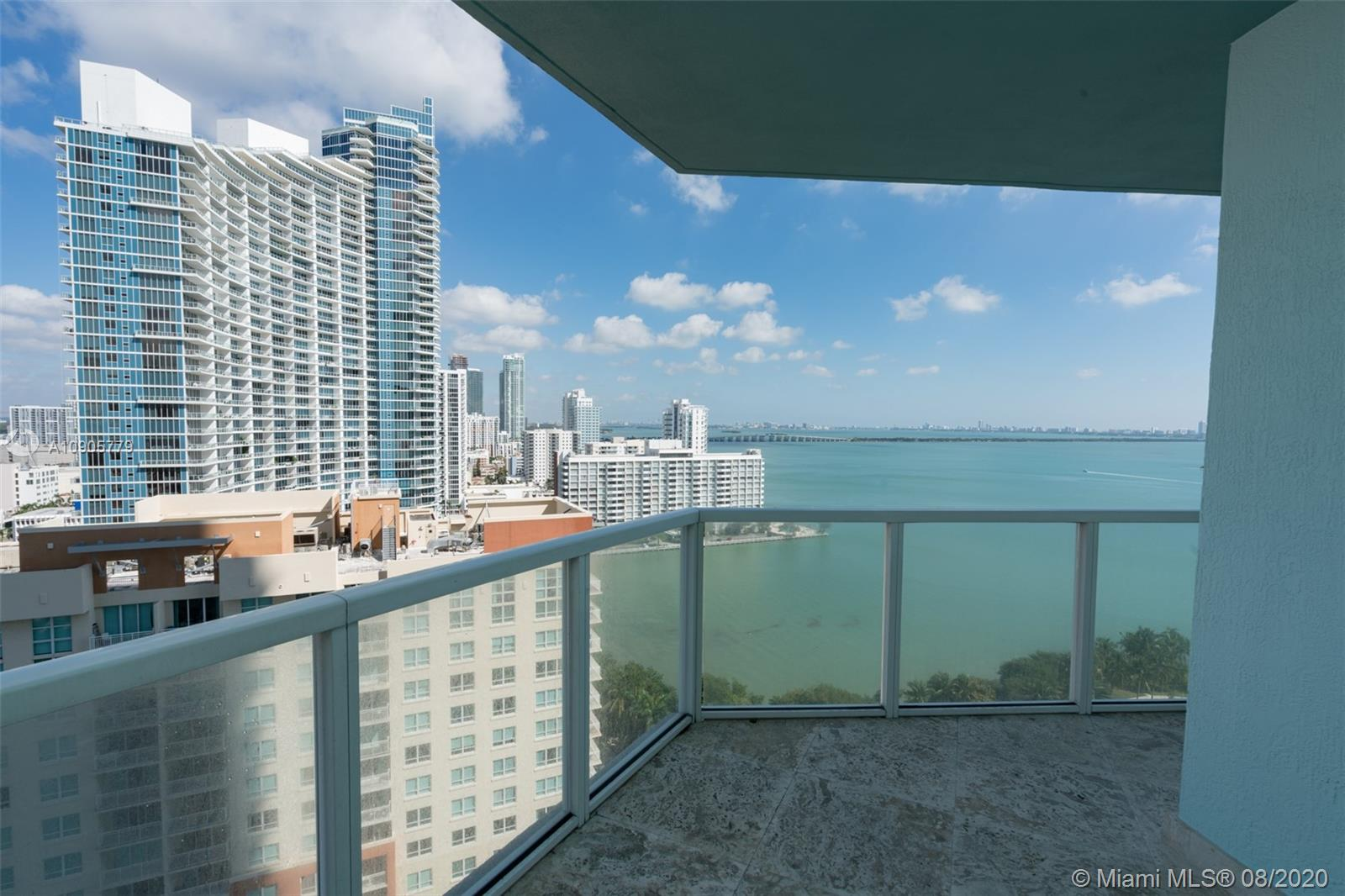 """Incredible 3 Bed / 3 Bath unit on the 19th floor at sought after Quantum on the Bay. Corner unit with direct-water and city views. 1,620 sq/ft of interior space with 254 sq/ft terrace per floor plan. Gourmet kitchen with Quartz counters & stainless steel appliances. Polished 24"""" marble flooring throughout and custom closets. Hi speed Internet & Cable included. Amenities 2 pools, Newly renovated fitness center, sauna, theater, club room, valet parking, convenience store in lobby. Centrally located on Edgewater close to Wynwood, Design district, Downtown Miami, Minutes to the Beach and Miami International Airport & more"""