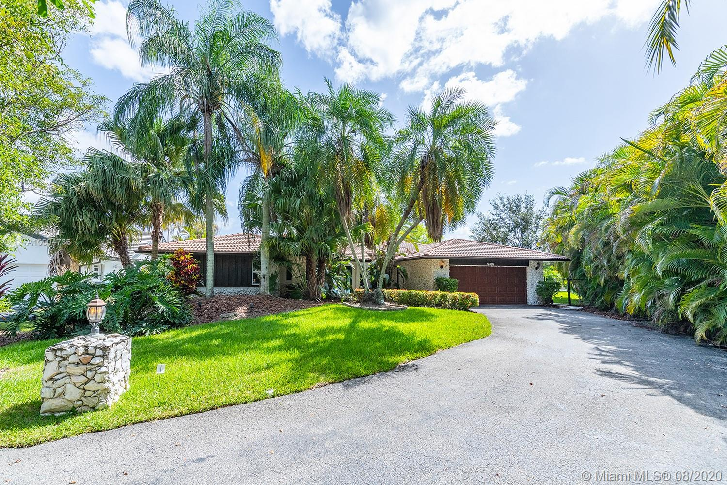 Outstanding 4 bed 2.5 bath house in Coral Springs! This home is spacious, both inside and out, with one of the largest lots in the neighborhood; over a quarter of an acre of land! Upon driving up to this home, you will notice the private, curved driveway leading up to the two car garage.Entering, you are greeted with an open layout and several windows leading to stunning views. This home features a resort style, heated pool overlooking the expansive yard and lake. All windows have been upgraded to thermal, hurricane impact windows so the house is covered for any storm and has an added bonus of being energy efficient. More energy efficient technologies  includes a Nest thermostat system.The kitchen comes complete with a gas range stove and a double oven. No HOA. Easy access to Expresswy